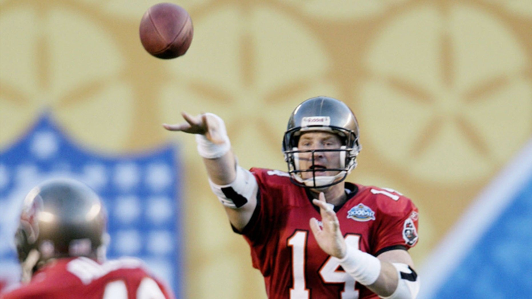 Jan. 26, 2003: Tampa Bay Buccaneers' quarterback Brad Johnson (14) throws to fullback Mike Alstott (40) for a first down in the second quarter of Super Bowl XXXVII, in San Diego.