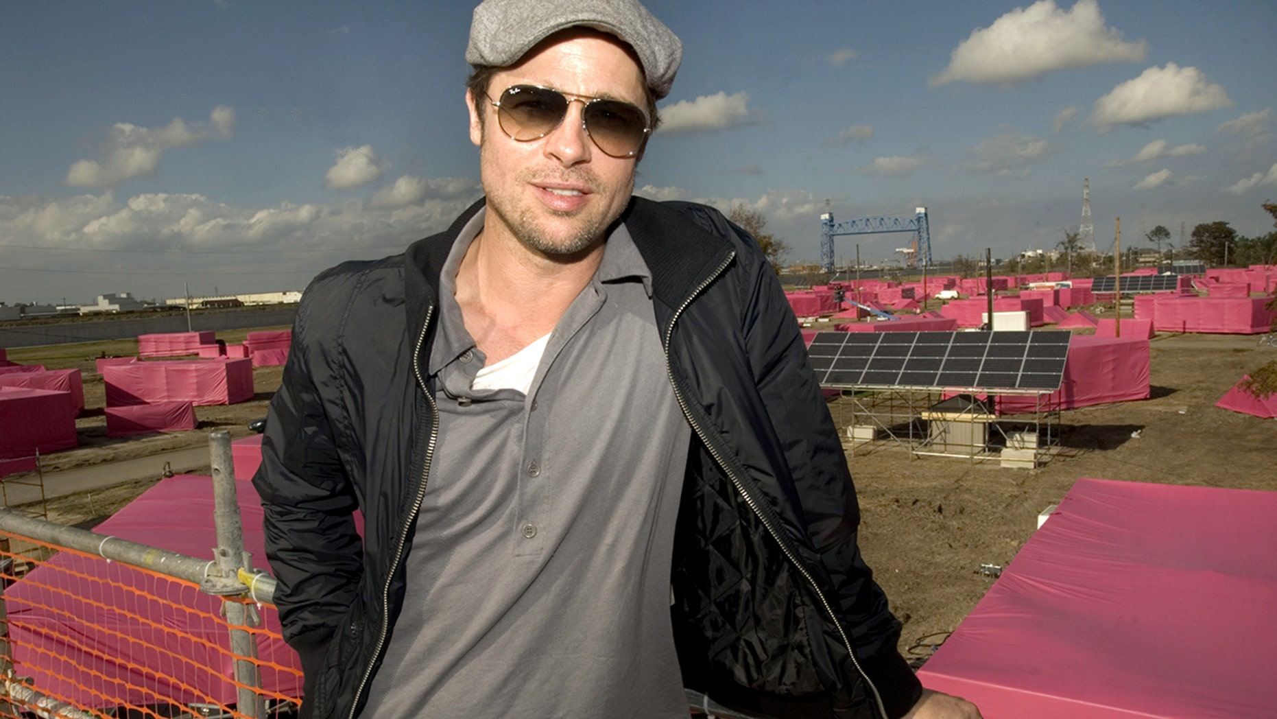 "Brad Pitt is pictured before pink stand-in structures (background) where 150 ecologically sustainable homes are to be built 03 December 2007 in the Lower 9th Ward of New Orleans, Louisiana. Pitt is spending $12 million with his ""Make It Right Project"" to build the homes where levees broke and floodwater pushed houses from their foundations during Hurricane Katrina in August 2005."