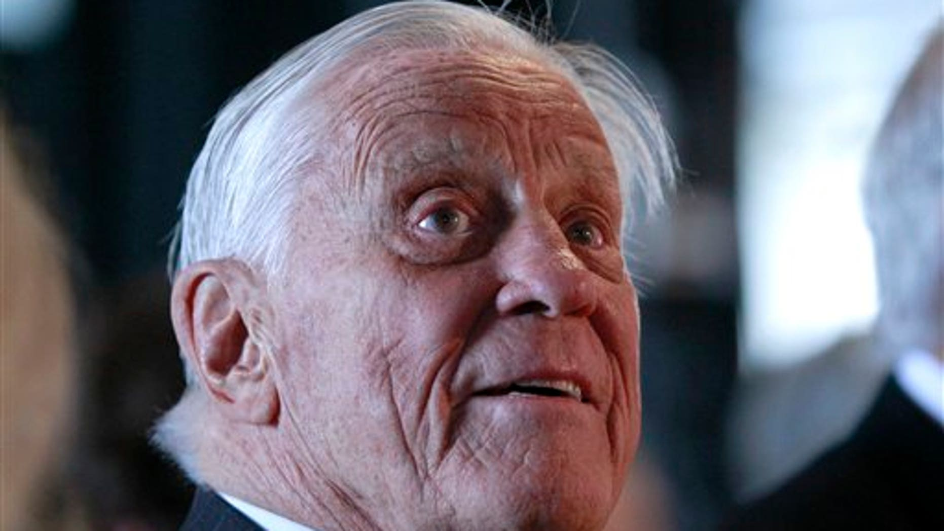 FILE: Ben Bradlee, former executive editor of The Washington Post, listens during an event sponsored by The Washington Post to commemorate the 40th anniversary of Watergate, at the Watergate office building in Washington.