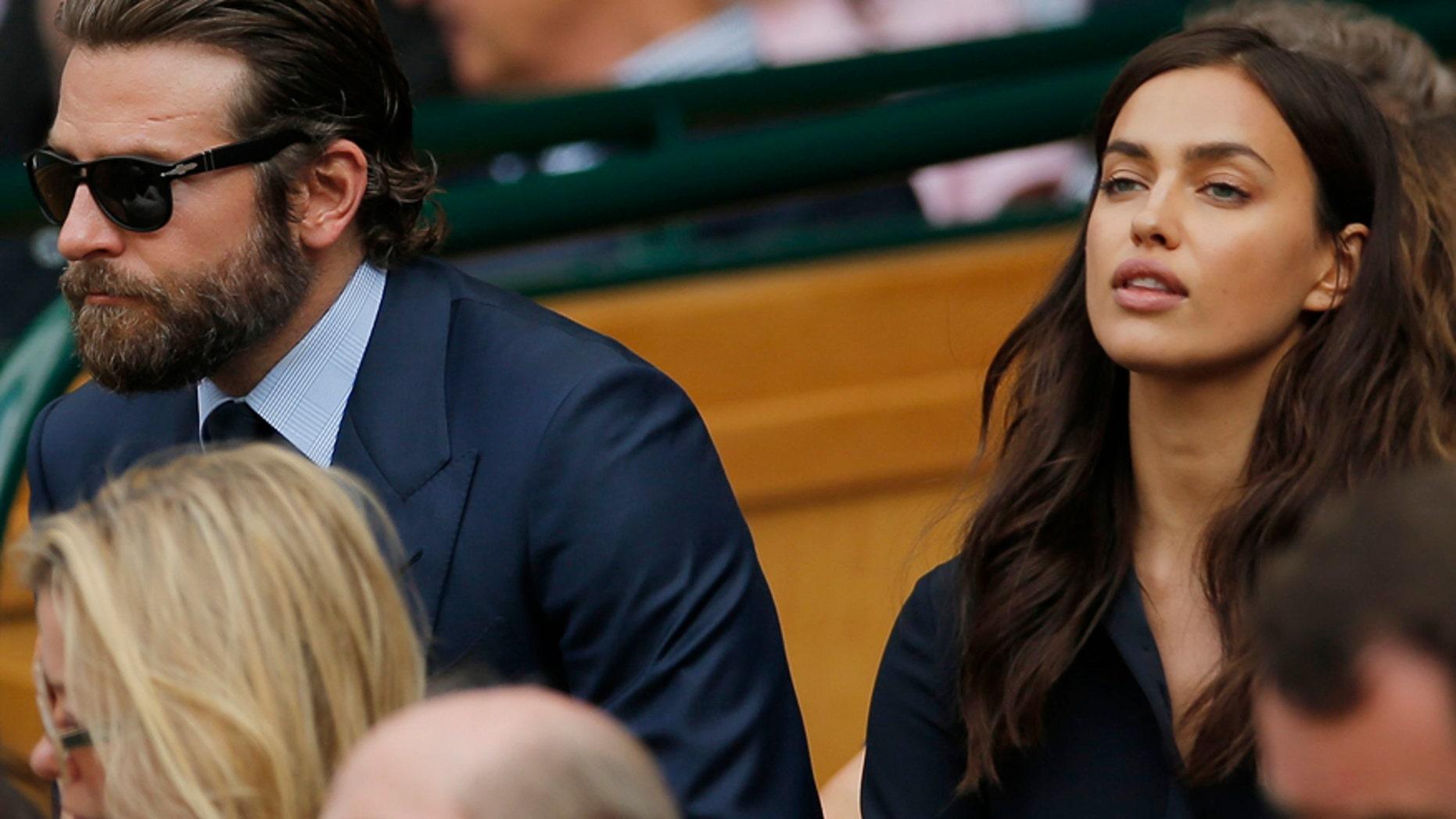 Britain Tennis - Wimbledon - All England Lawn Tennis & Croquet Club, Wimbledon, England - 10/7/16 Actor Bradley Cooper and his girlfriend model Irina Shayk in the royal box on centre court.
