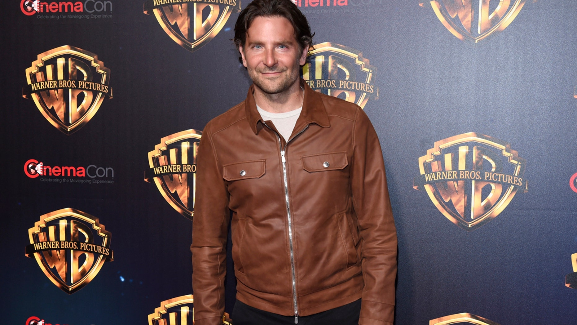 Bradley Cooper arrives at the Warner Bros. presentation at CinemaCon 2018, the official convention of the National Association of Theatre Owners, at Caesars Palace on Tuesday, April 24, 2018, in Las Vegas. (Photo by Chris Pizzello/Invision/AP)