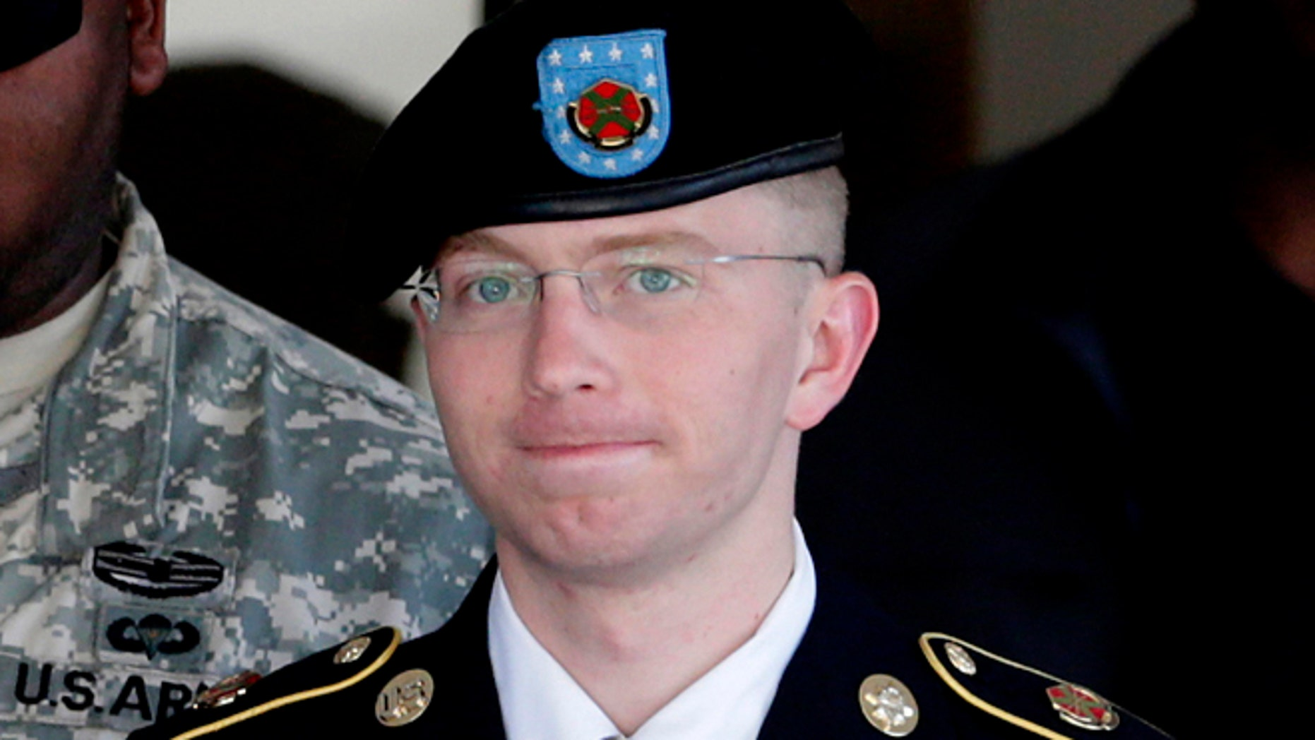 FILE: June 25, 2012: Army Pfc. Bradley Manning, right, is escorted out of a courthouse in Fort Meade, Md.