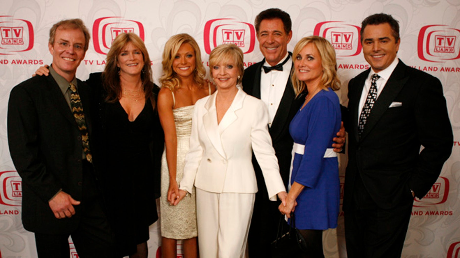 Barry Williams (fifth from left) remembers his TV mom Florence Henderson who passed away.