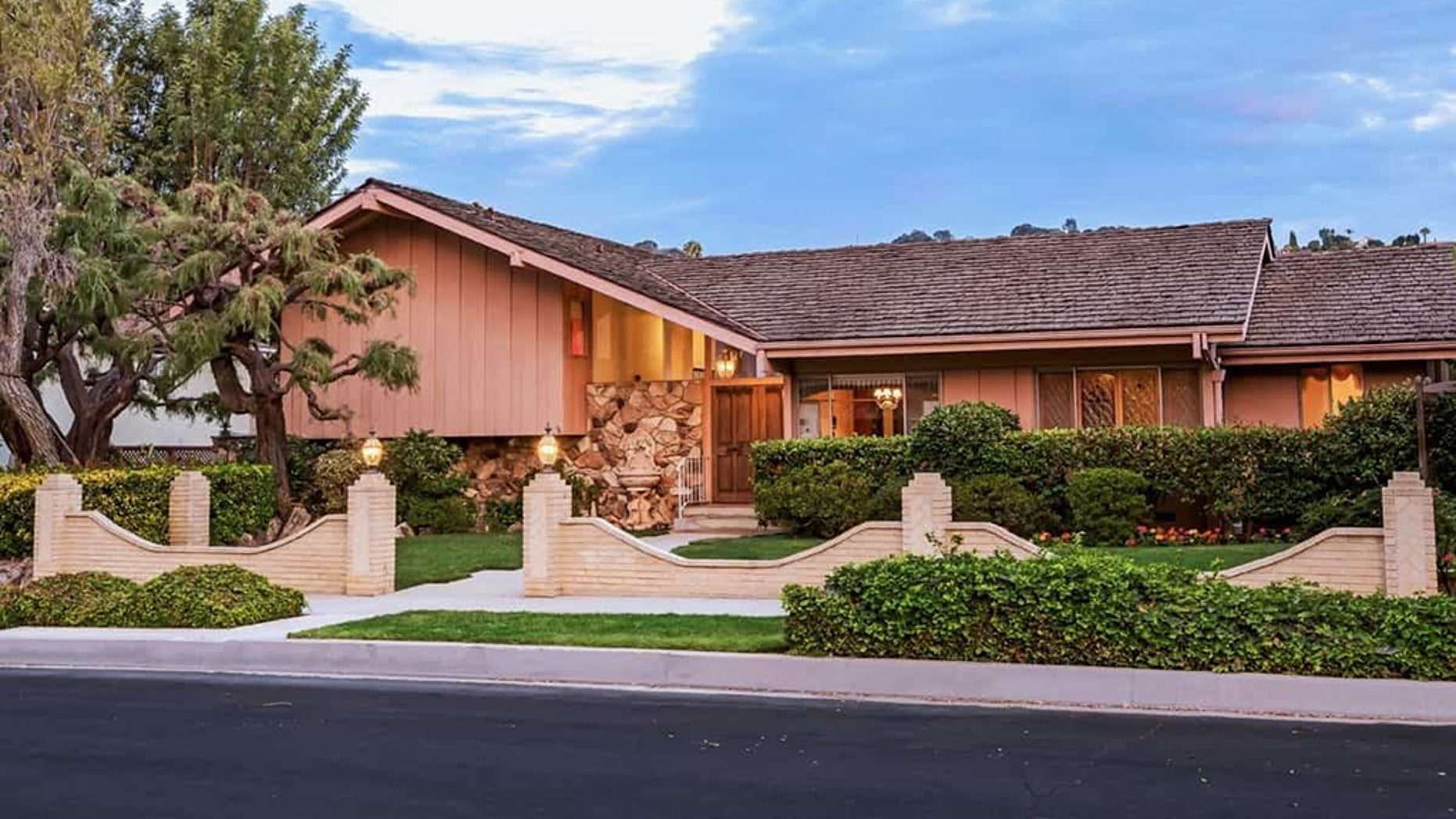 """With the exception of a few updates and a gate surrounding the property, the home looks largely the same as """"Brady Bunch"""" fans recall.  (Anthony Barcelo/Carswell and Partners)"""