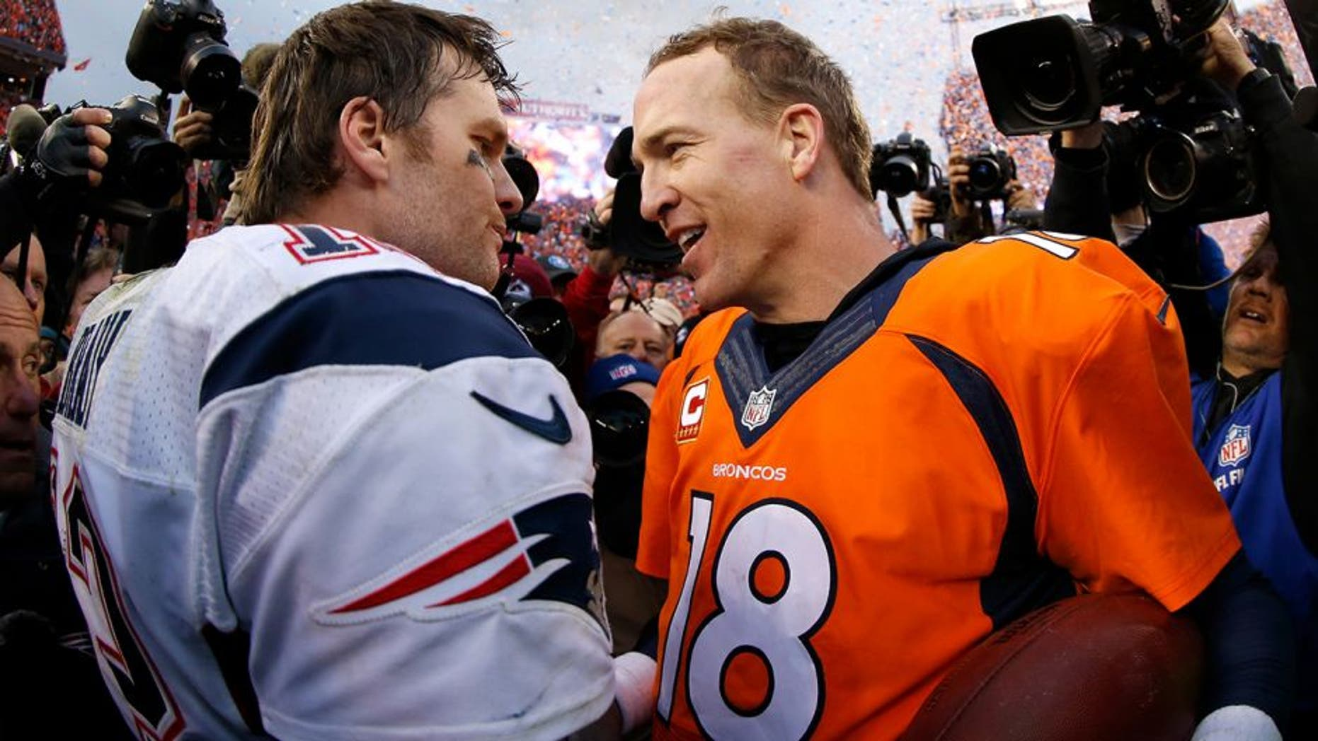 DENVER, CO - JANUARY 24: Peyton Manning #18 of the Denver Broncos and Tom Brady #12 of the New England Patriots speak after the AFC Championship game at Sports Authority Field at Mile High on January 24, 2016 in Denver, Colorado. The Broncos defeated the Patriots 20-18. (Photo by Ezra Shaw/Getty Images)
