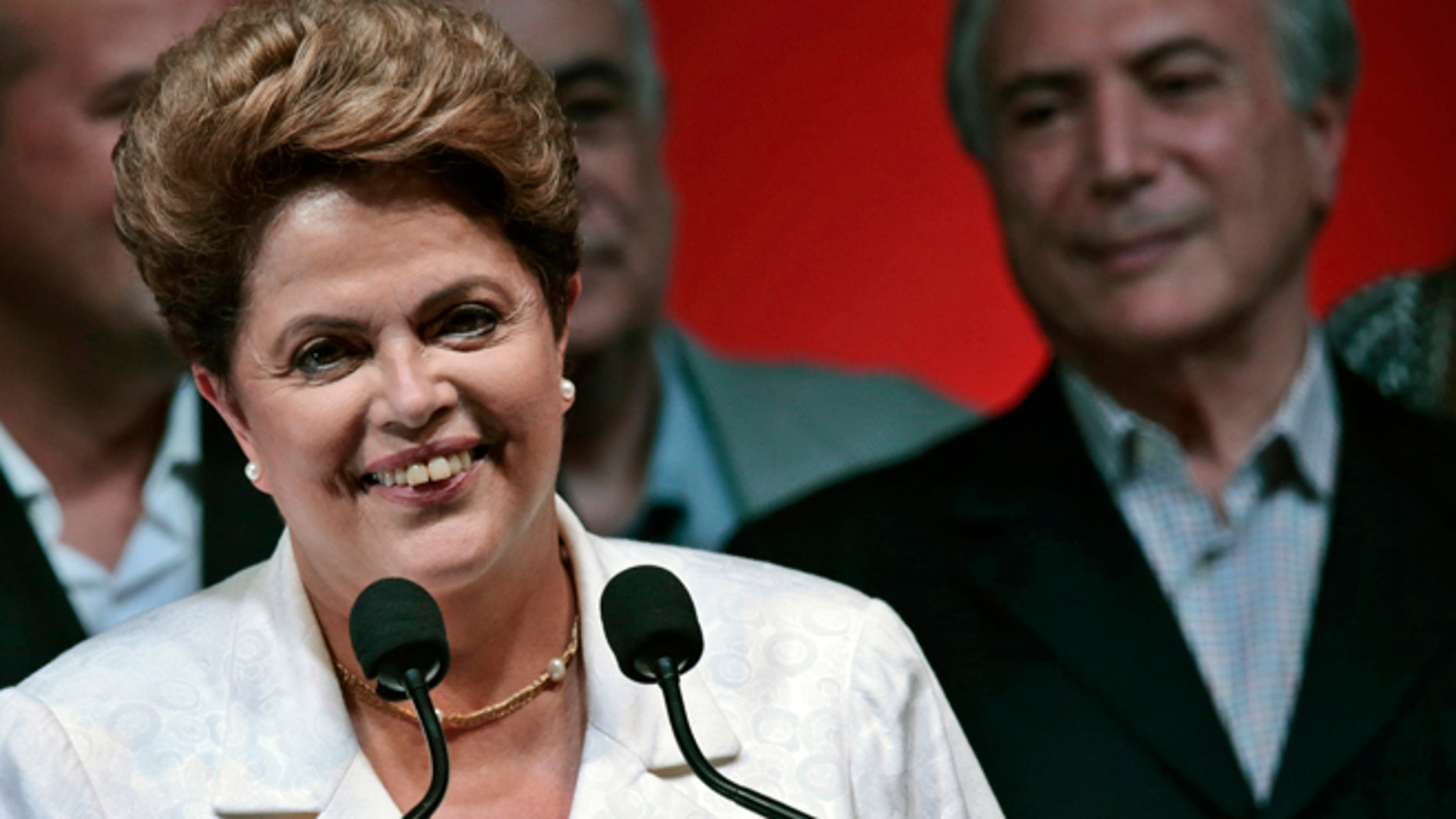 Oct. 26: Dilma Rousseff smiles during news conference after disclosure of the election results, in Brasilia.