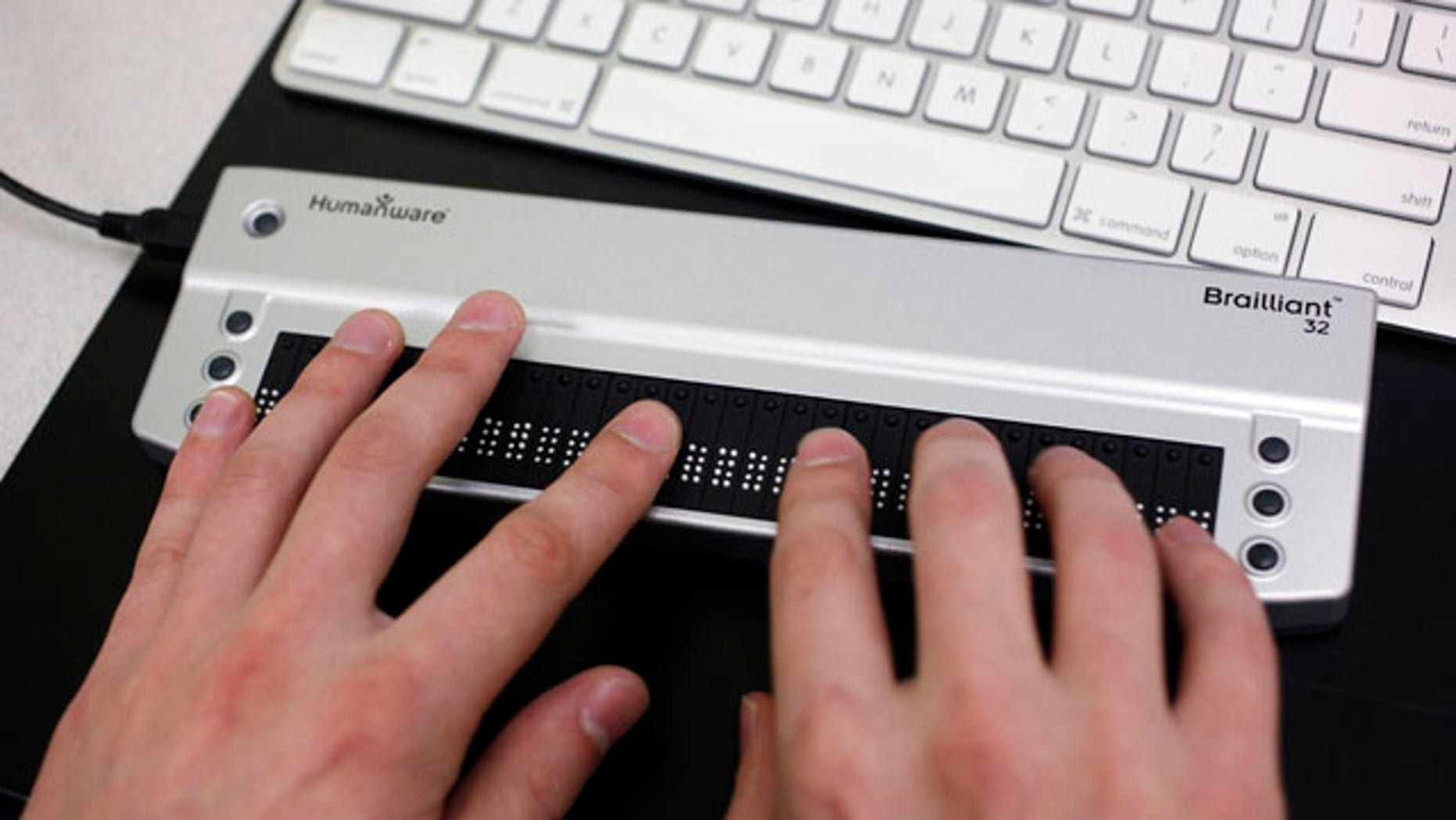 """Victor Tsaran, co-director of Yahoo's """"Accessibility Lab,"""" uses a Braille keyboard at headquarters in Sunnyvale, Calif. The """"Accessibility Lab lets programmers and developers try various assistive technology software and hardware such as screen readers, Braille keyboards and other tools employed by disabled users to navigate the Web."""