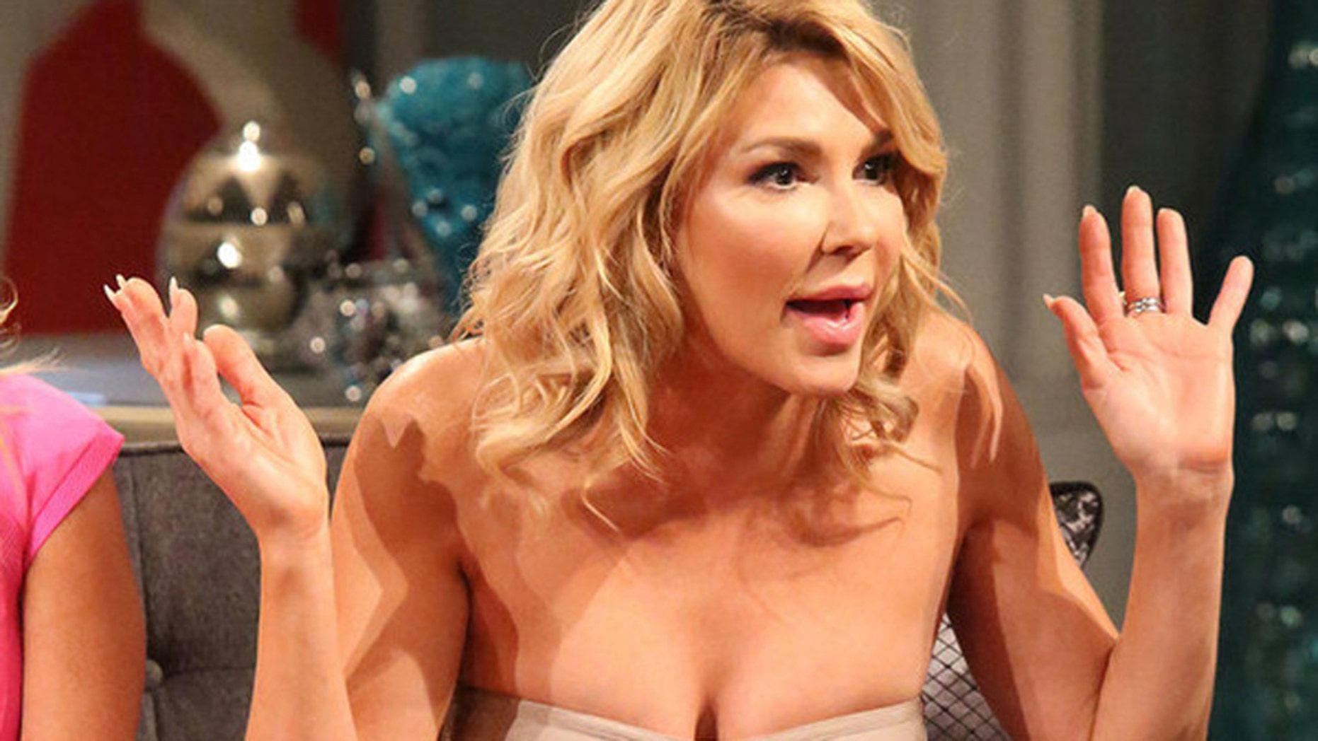 """Brandi Glanville on """"The Real Housewives of Beverly Hills"""" reunion. (Photo by: Evans Vestal Ward/Bravo)"""