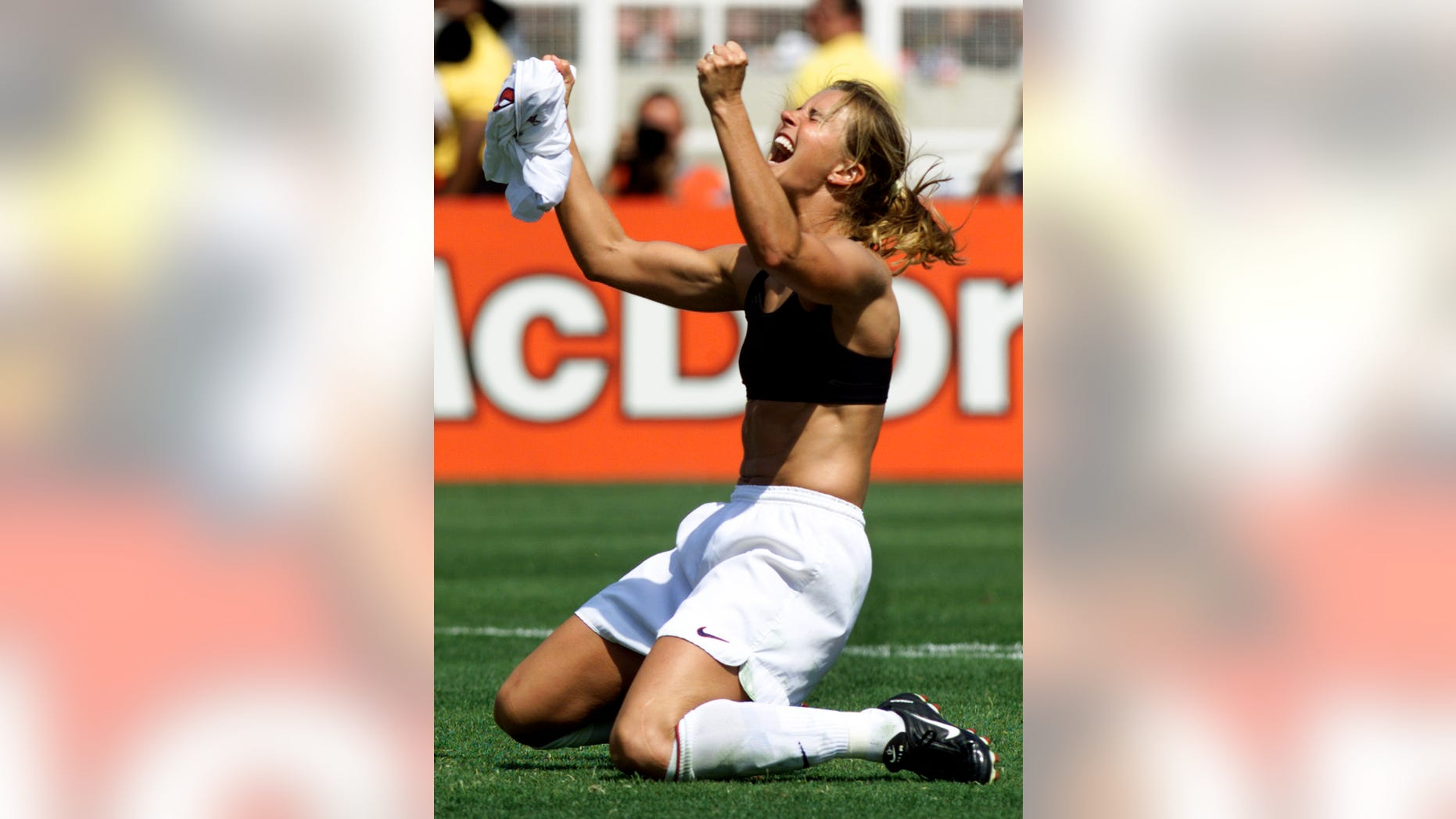 Brandi Chastain celebrates her winning penalty kick to defeat China 5-4 at the Women's World Cup soccer final between the two countries, July 10, 1999 at the Rose Bowl.