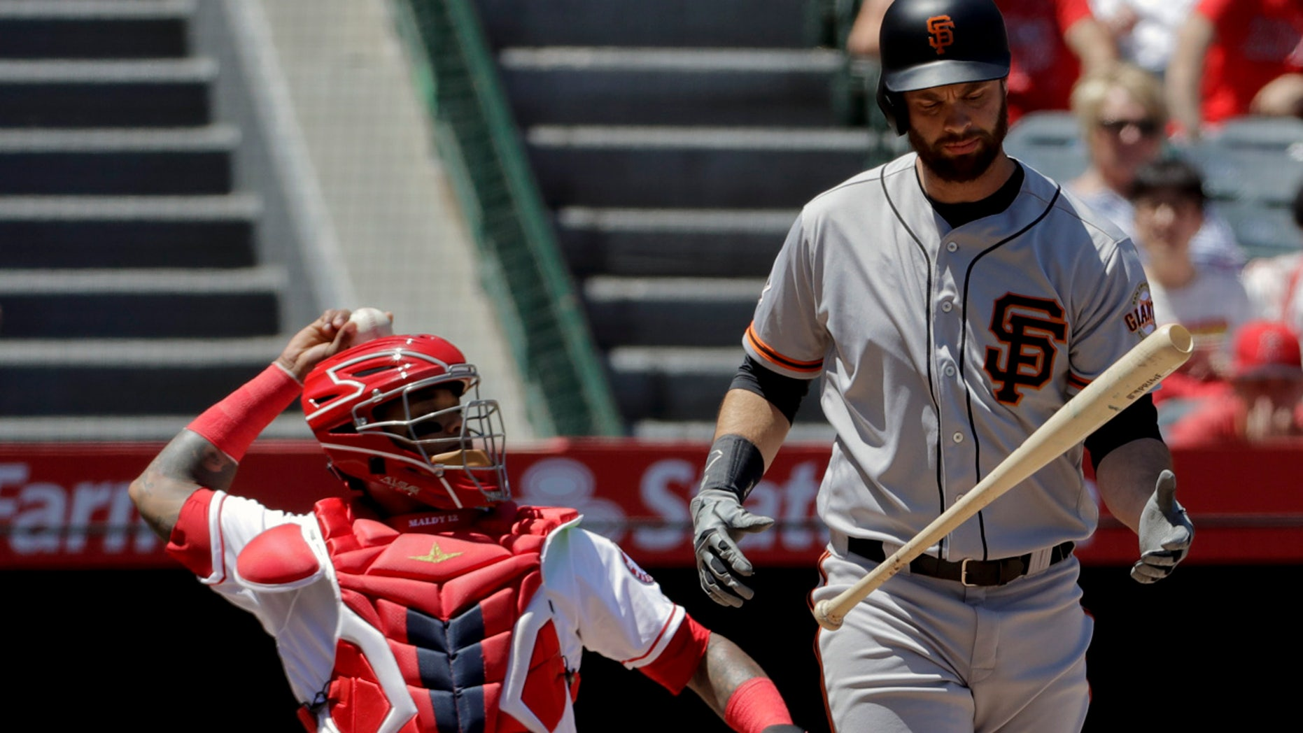 Brandon Belt reacts after hitting a foul ball during his 21-pitch first-inning at-bat Sunday afternoon.