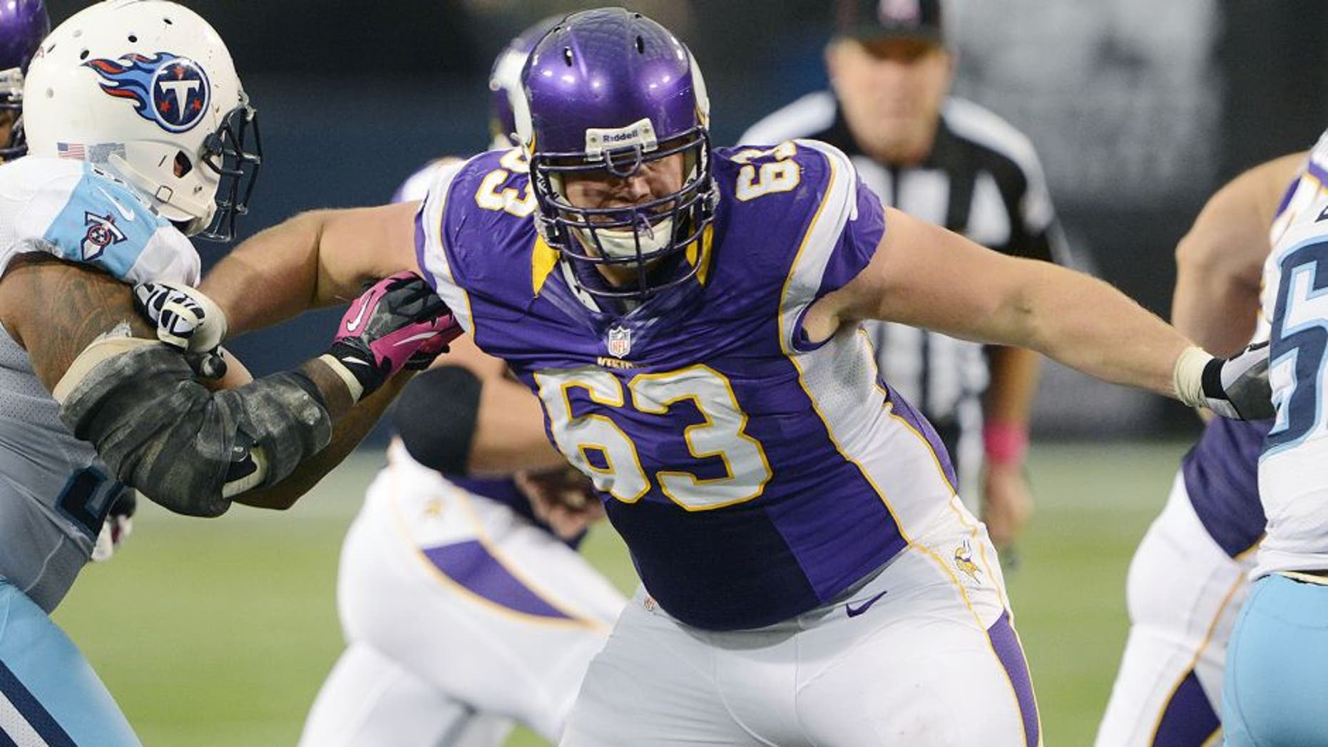 MINNEAPOLIS - OCTOBER 7: Brandon Fusco #63 of the Minnesota Vikings blocks during an NFL game against the Tennessee Titans at Mall of America Field at the Hubert H. Humphrey Metrodome on October 7, 2012 in Minneapolis, Minnesota. (Photo by Tom Dahlin/Getty Images)