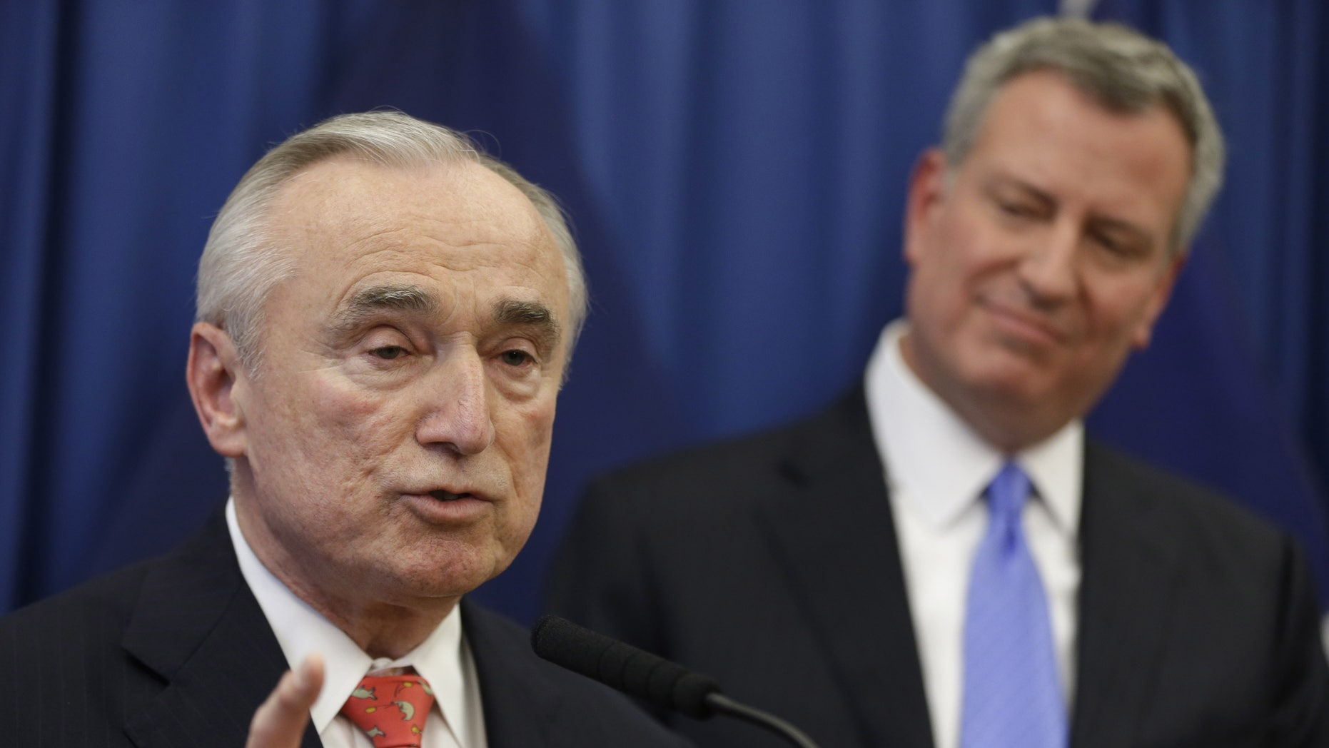 FILE -  In this Dec. 5, 2013 file photo, William Bratton, left, speaks while New York Mayor-elect Bill de Blasio looks on during a news conference in New York introducing Bratton as de Blasio's choice for New York City police commissioner. Although Bratton is a proponent of the police tactic known as stop and frisk, which de Blasio says was used too much during the Bloomberg years, both men have pledged to better explain the use of the tactic and de Blasio has vowed to drop the Bloomberg administrations objections to a pair of watchdogs - both an independent general and a federal monitor - who have been tasked with overseeing the NYPD. (AP Photo/Seth Wenig, File)