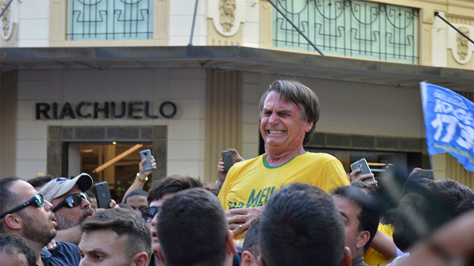 Brazilian presidential candidate Jair Bolsonaro grimaces after being stabbed in the stomach during a campaign rally in Juiz de Fora, Brazil on Thursday.