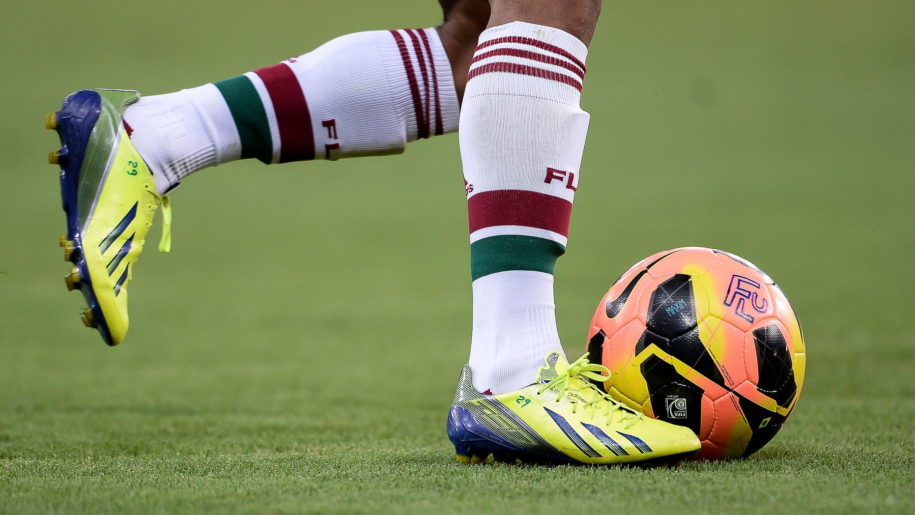 RIO DE JANEIRO, BRAZIL - OCTOBER 27: Detail of Fluminense boot shoes during a match between Fluminense and Vitoria as part of Brazilian Serie A 2013  at Aterro do Flamengo on October 27, 2013 in Rio de Janeiro, Brazil. (Photo by Buda Mendes/Getty Images)