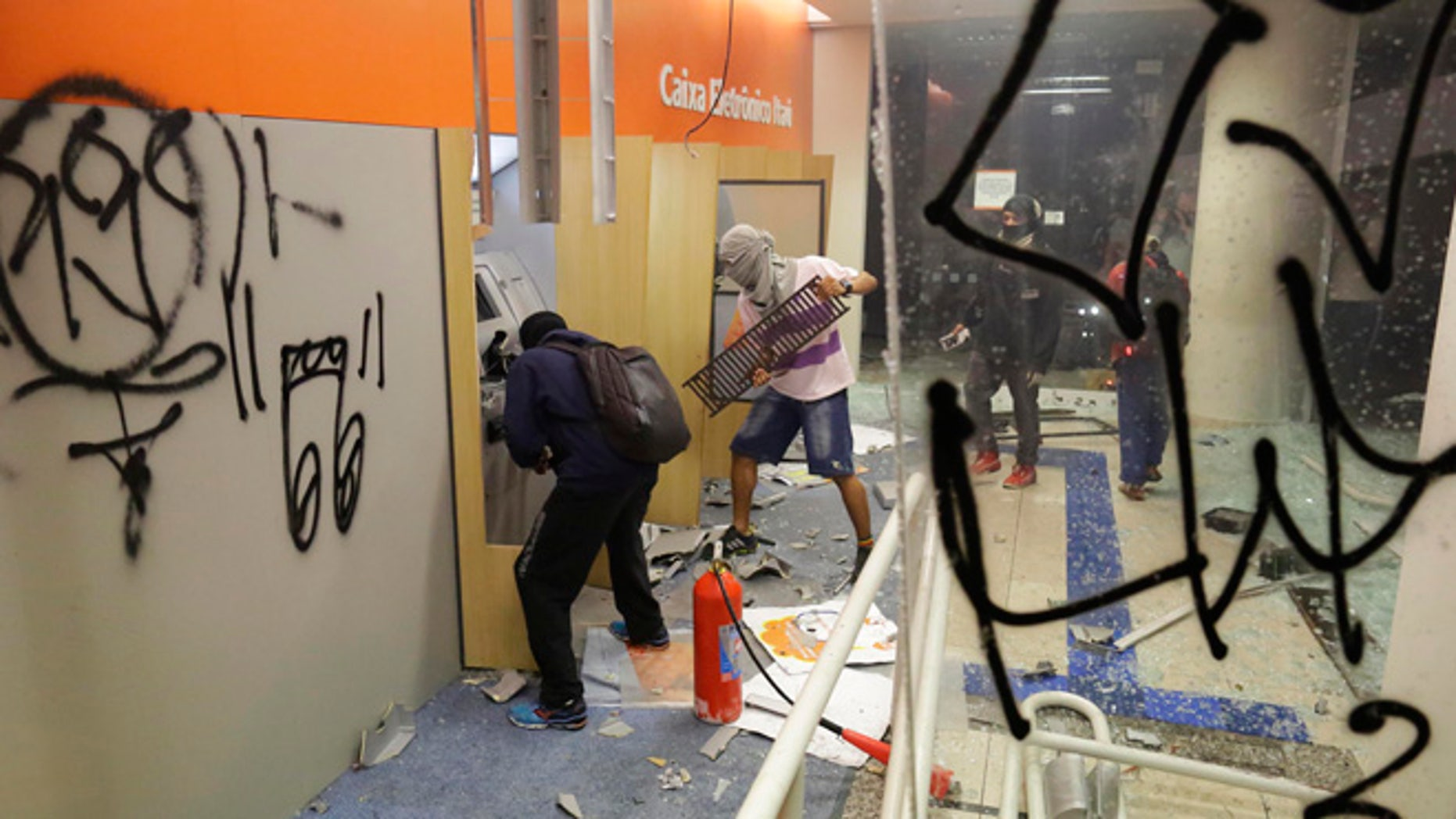 June 18, 2013: Protestors destroy ATM machines at a local a bank in Sao Paulo, Brazil. Thousands of demonstrators flooded into a square in Brazil's economic hub, Sao Paulo, on Tuesday. Sparked earlier this month by a 10-cent hike in bus and subway fares and organized via social media, the nationwide protests are giving voice to growing discontent over the gap between Brazils high tax burden and the low quality of public infrastructure, echoing similar mobilizations in Turkey, Greece and other parts of the globe where weariness with governments has exploded in the streets.