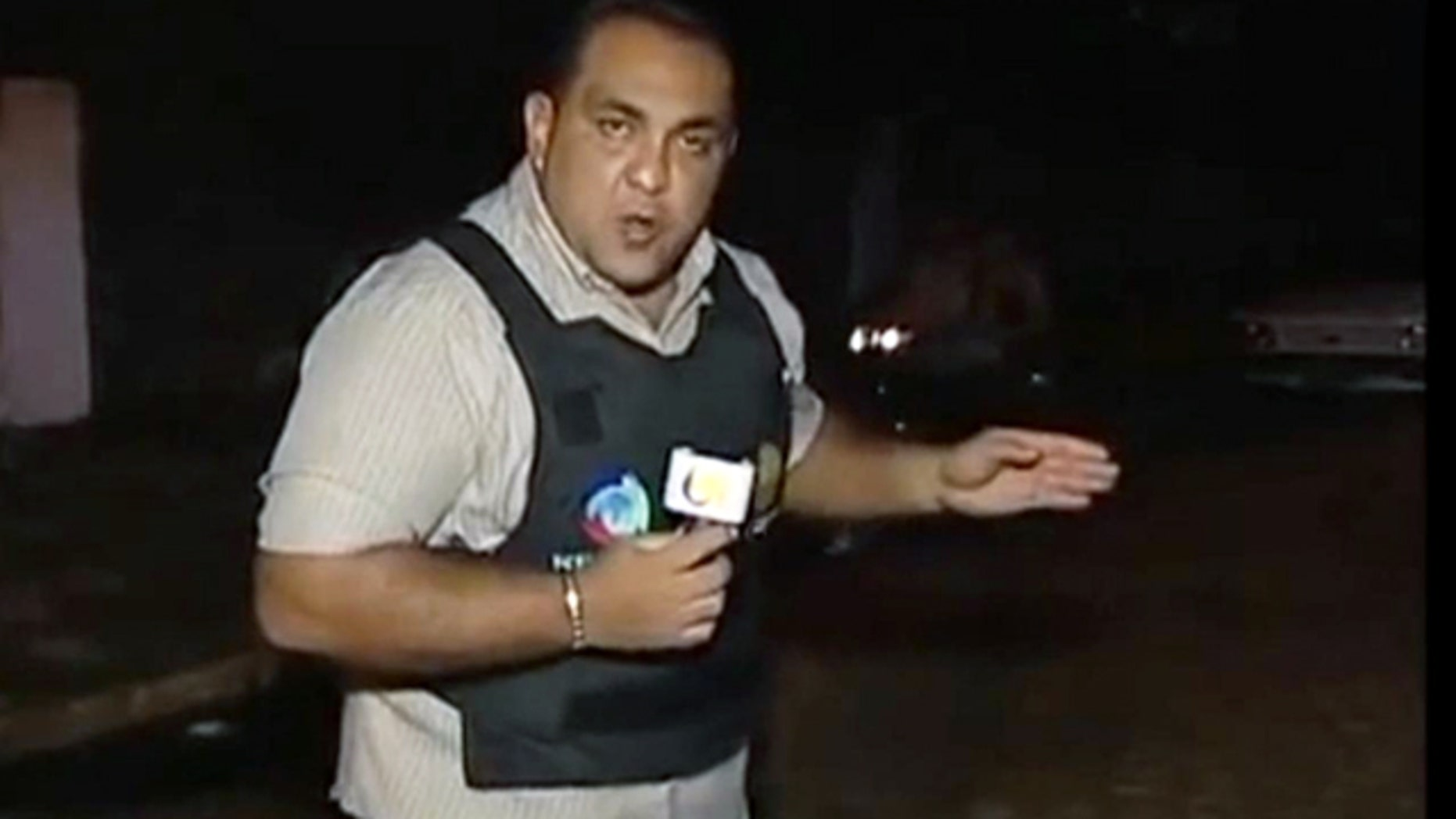 This screenshot from a video posted on YouTube purports to show TV reporter Josenlindo Gonclaves before his TV crew filmed a live shooting.