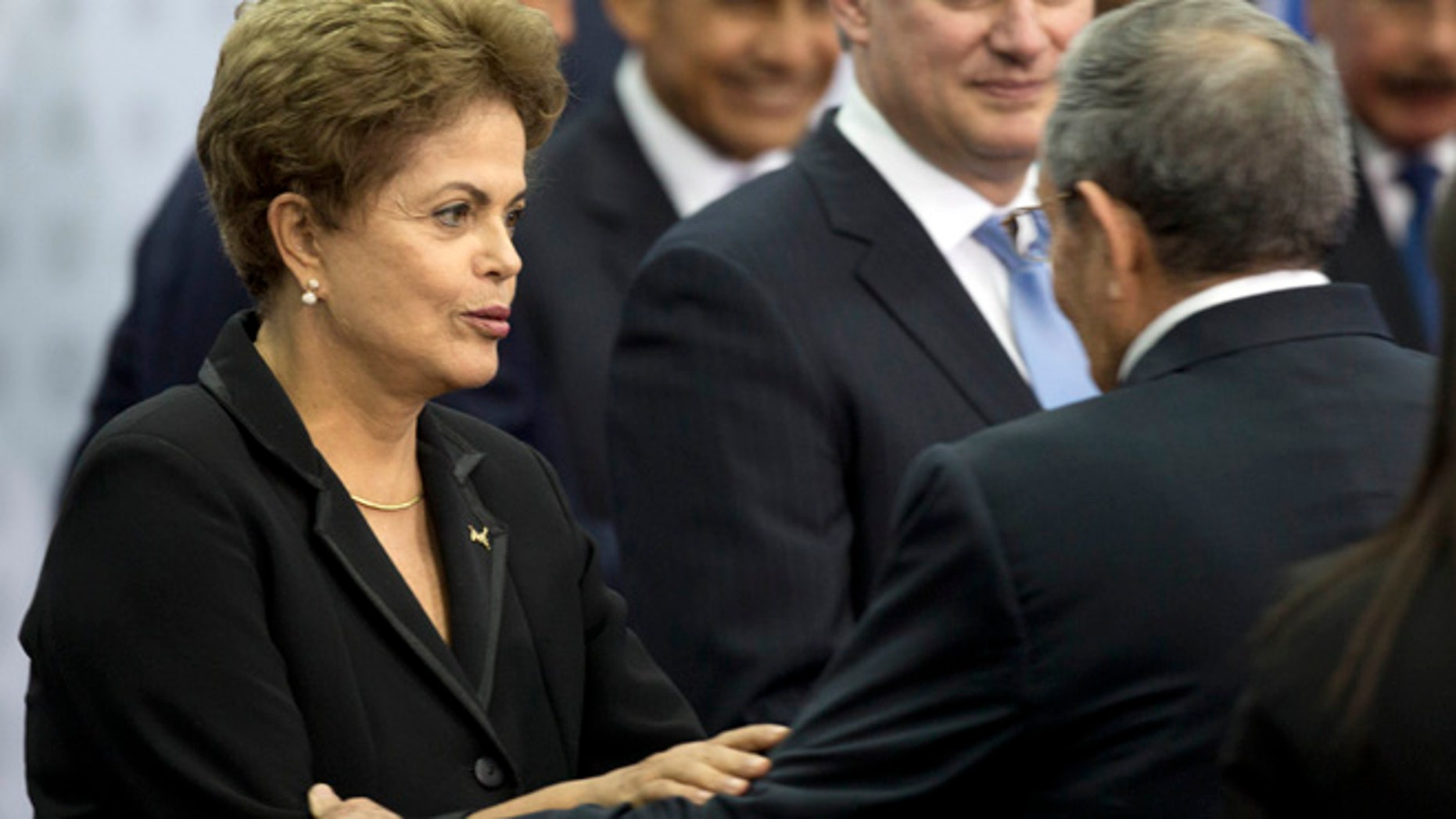 Apr. 11, 2015: Brazil's President Dilma Rousseff greets Cuba's President Raul Castro as they arrive for the oficial group photo of the VII Summit of the Americas in Panama City, Panama. (AP)