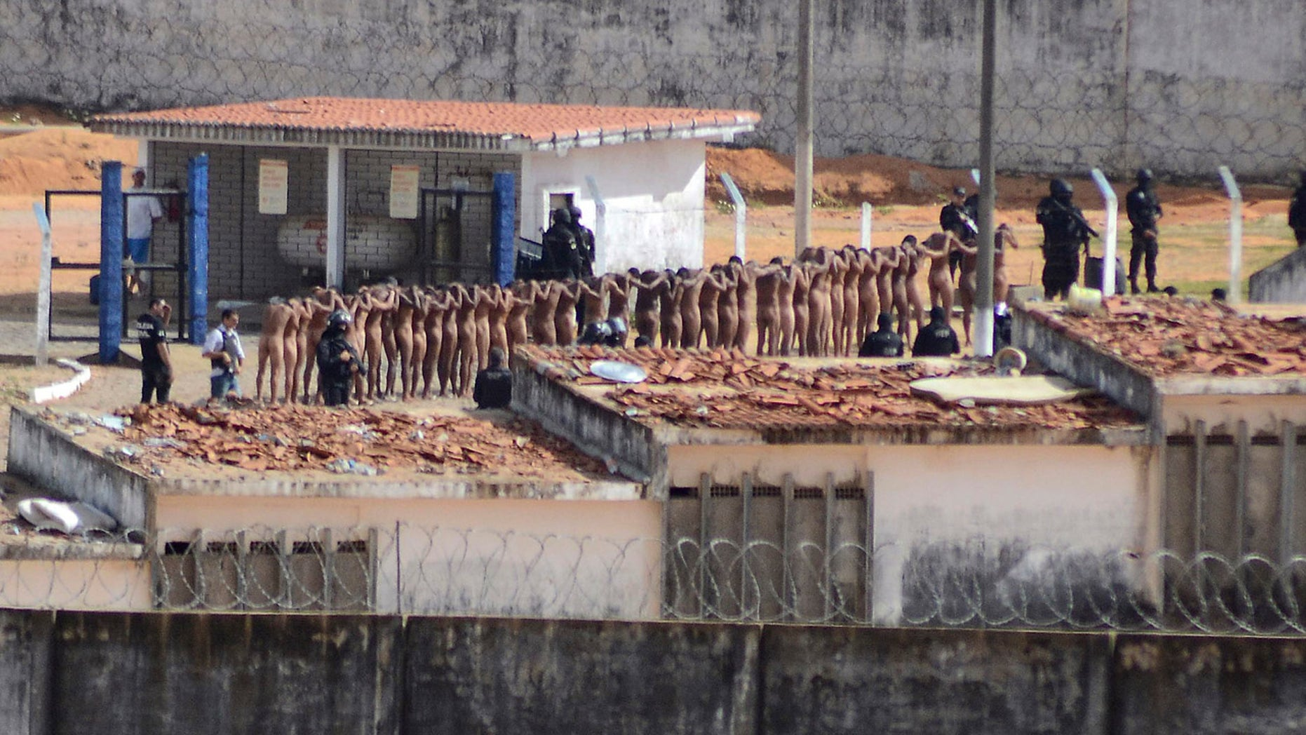 Jan. 15, 2017: Naked inmates stand in line while surrounded by police after a riot at the Alcacuz prison in Nisia Floresta, Rio Grande do Norte state, Brazi.
