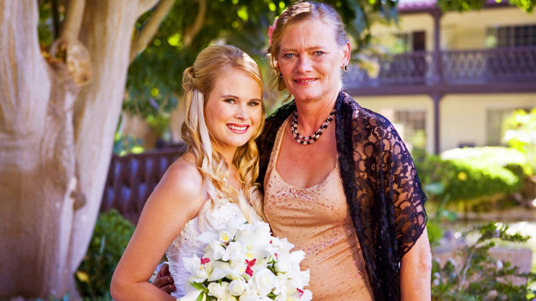 Amanda and her mother on her wedding day (image courtesy subject)