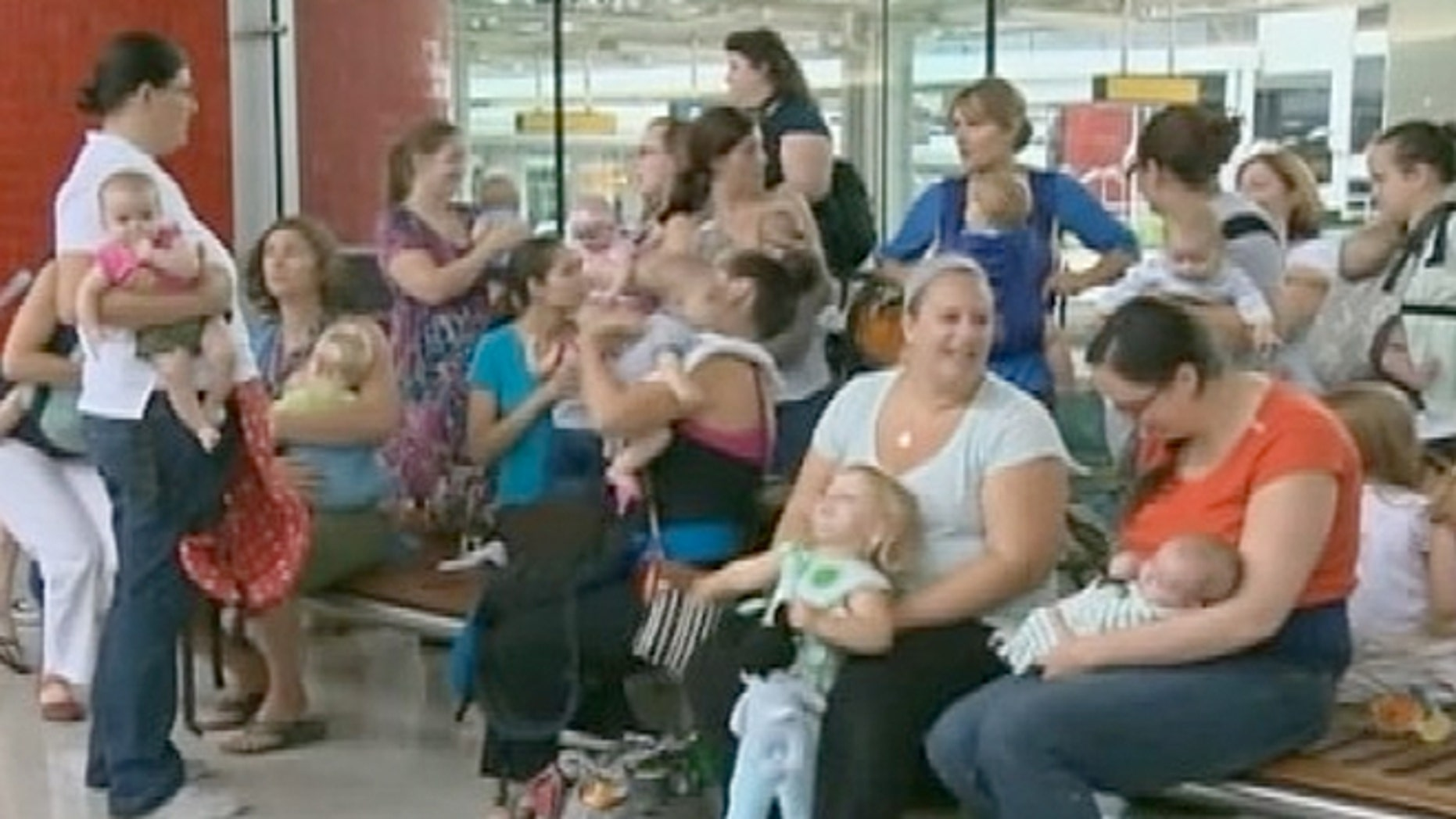 A group of about 25 nursing mothers and their nursing children gathered Wednesday at Baltimore-Washington International Thurgood Marshall Airport to protest the airlines.