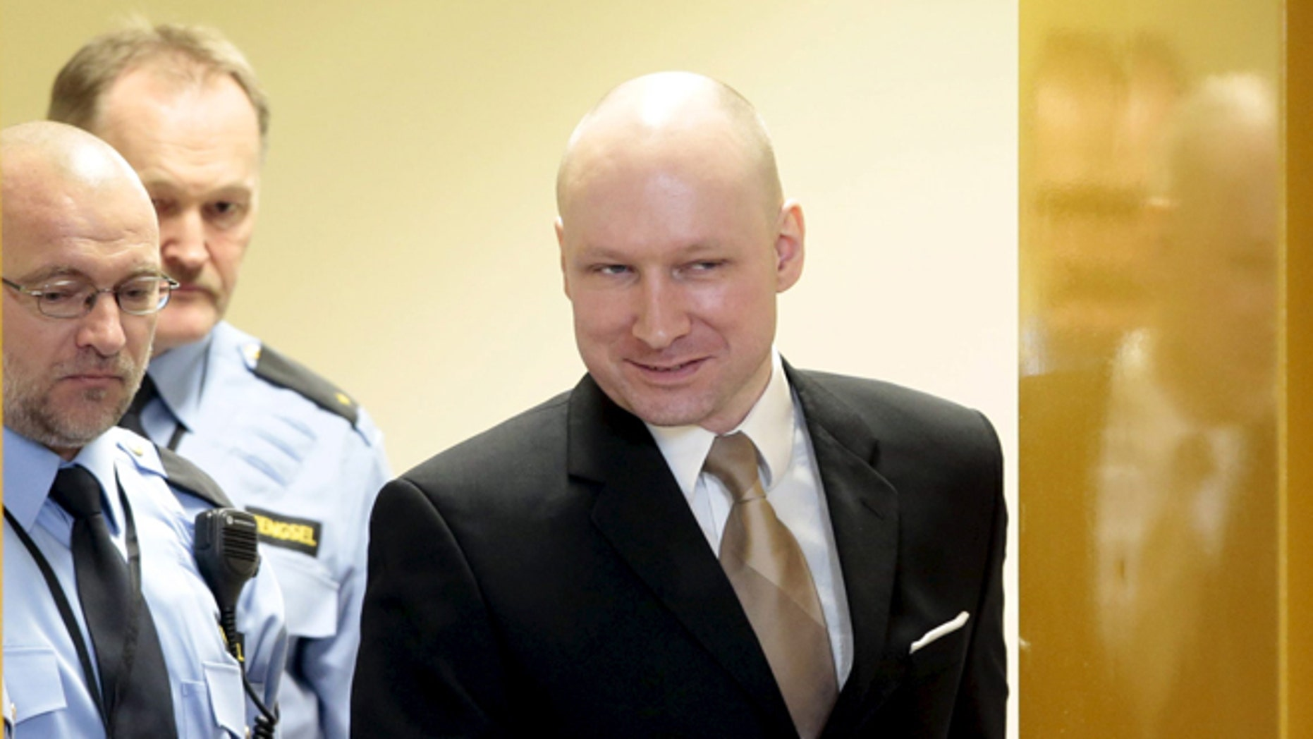 March 15, 2016: Mass killer Anders Behring Breivik is escorted by prison guards as he enters the court room in Skien prison. He recently filed a claim that his human rights were violated by being in solitary confinement. (Reuters)