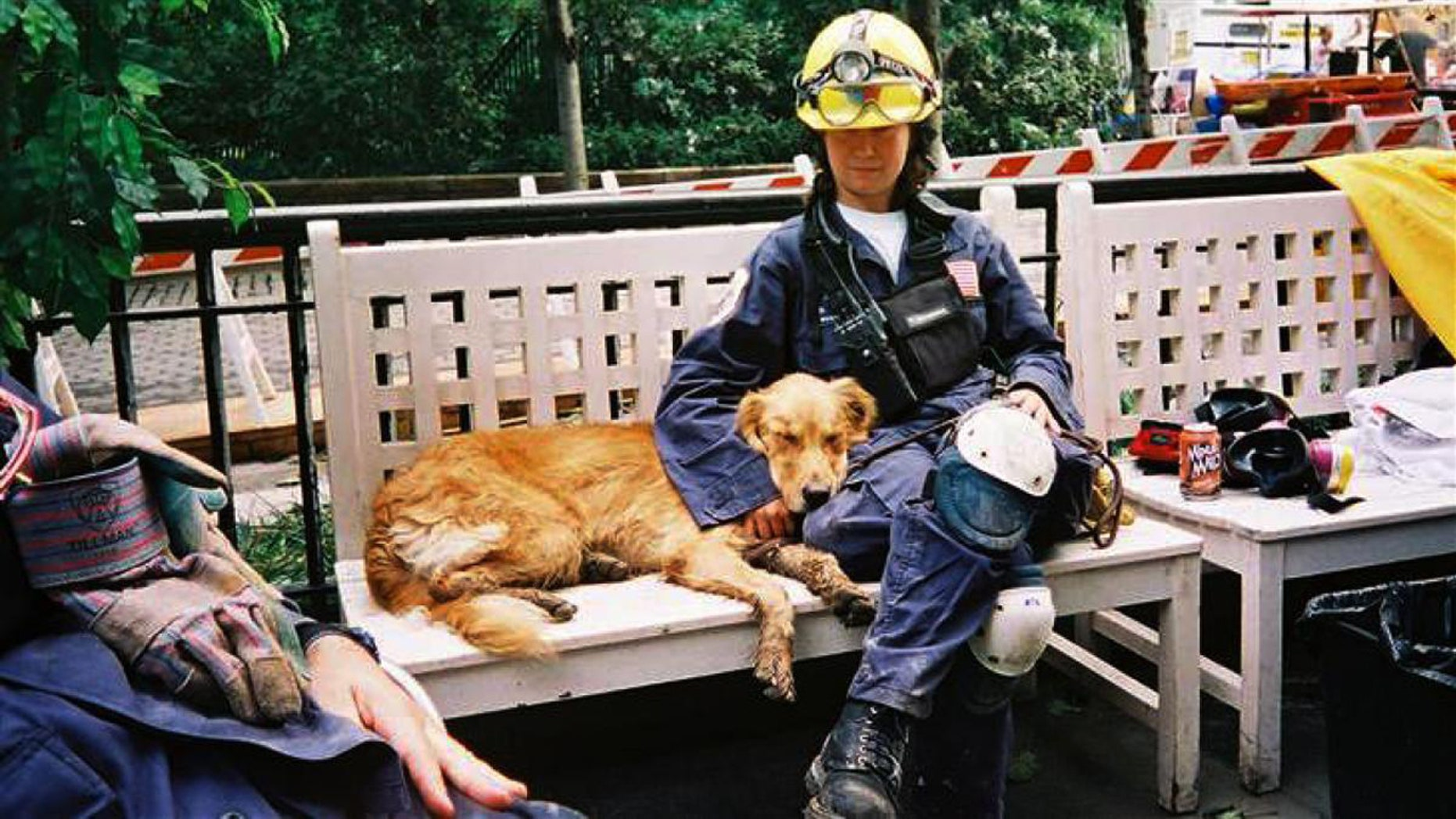 In this undated photo, search dog Bretagne rests alongside handler Denise Corliss while searching Ground Zero after the 9/11 attacks