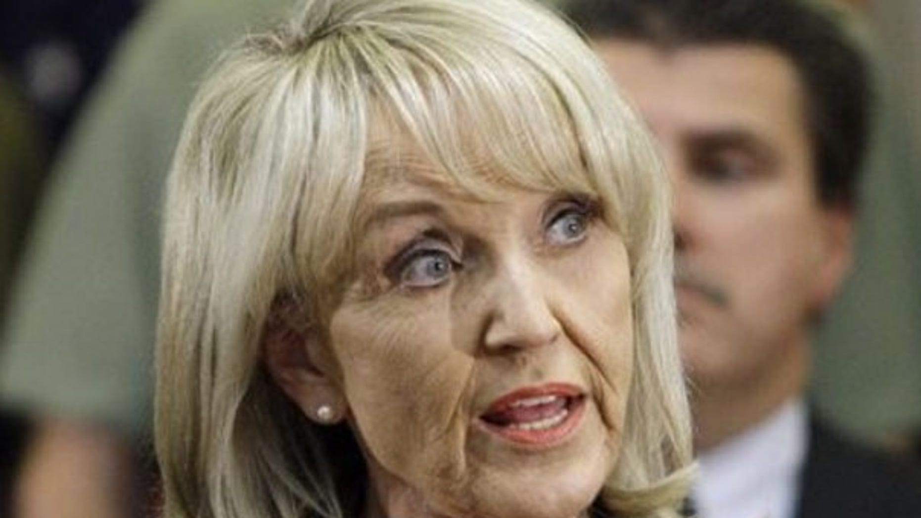Arizona Gov. Jan Brewer speaks during a news conference after signing her state's immigration bill April 23 in Phoenix. (AP Photo)