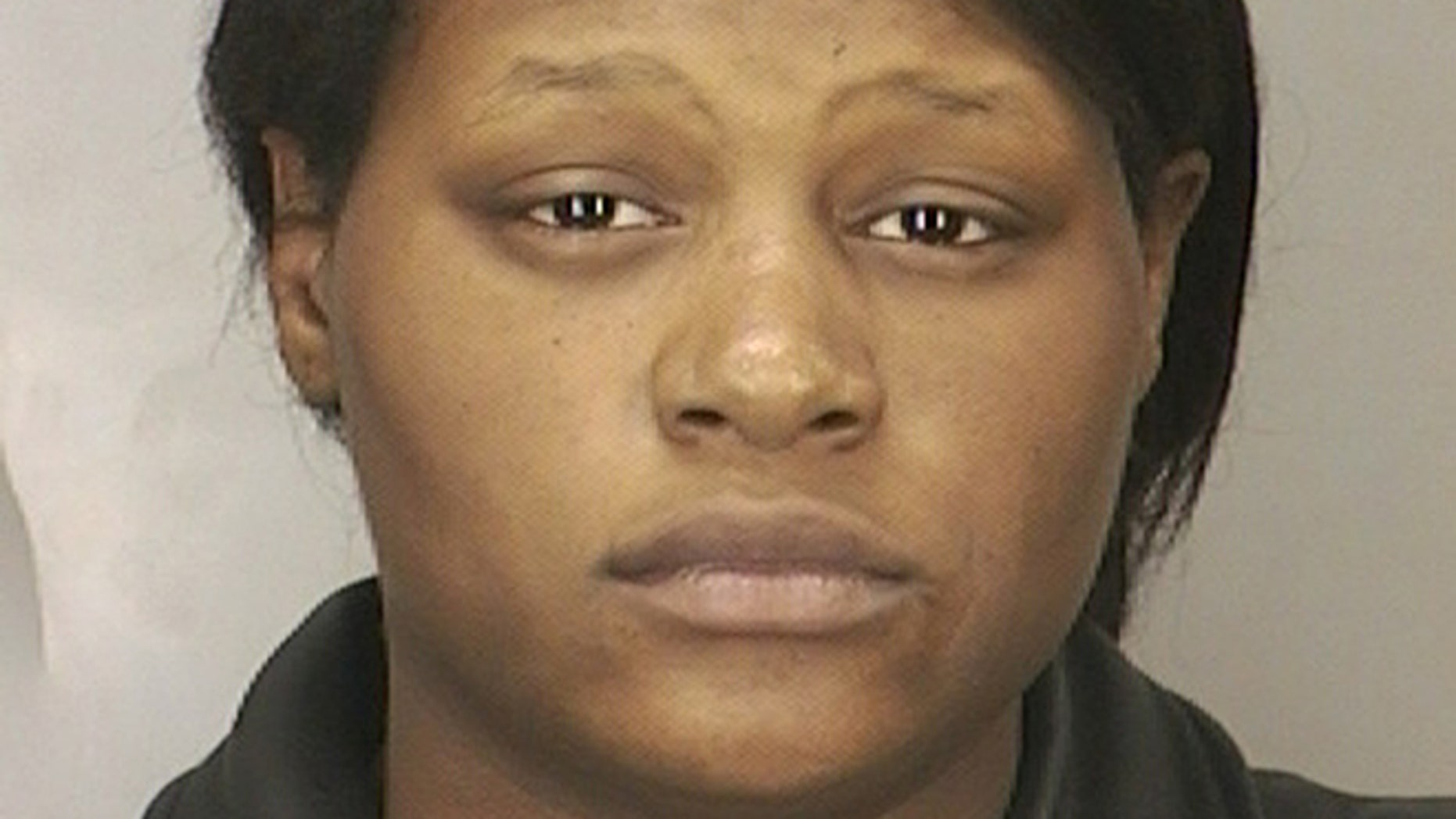 Leatrice Brewer is seen in this 2003 arrest photo provided by the Nassau County Police Department. A judge is holding a hearing Wednesday Nov. 6, 2013 to determine whether a Long Island mother found not guilty because of mental disease in the 2008 drowning of her three children deserves a piece of their $350,000 estate. (AP/Nassau County Police Department)