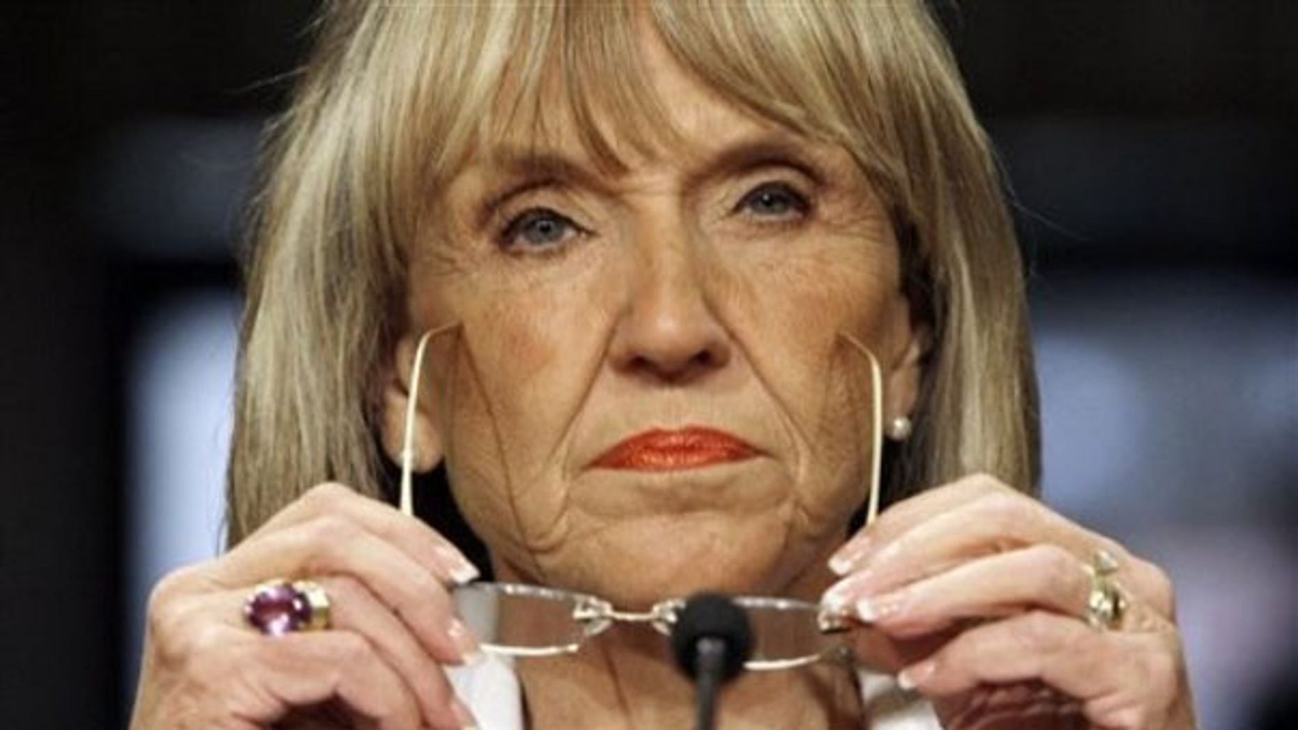 Arizona Gov. Jan Brewer listens to a question as she testifies during a U.S. Senate committee meeting on border violence April 20, 2009, in Phoenix. (AP Photo)