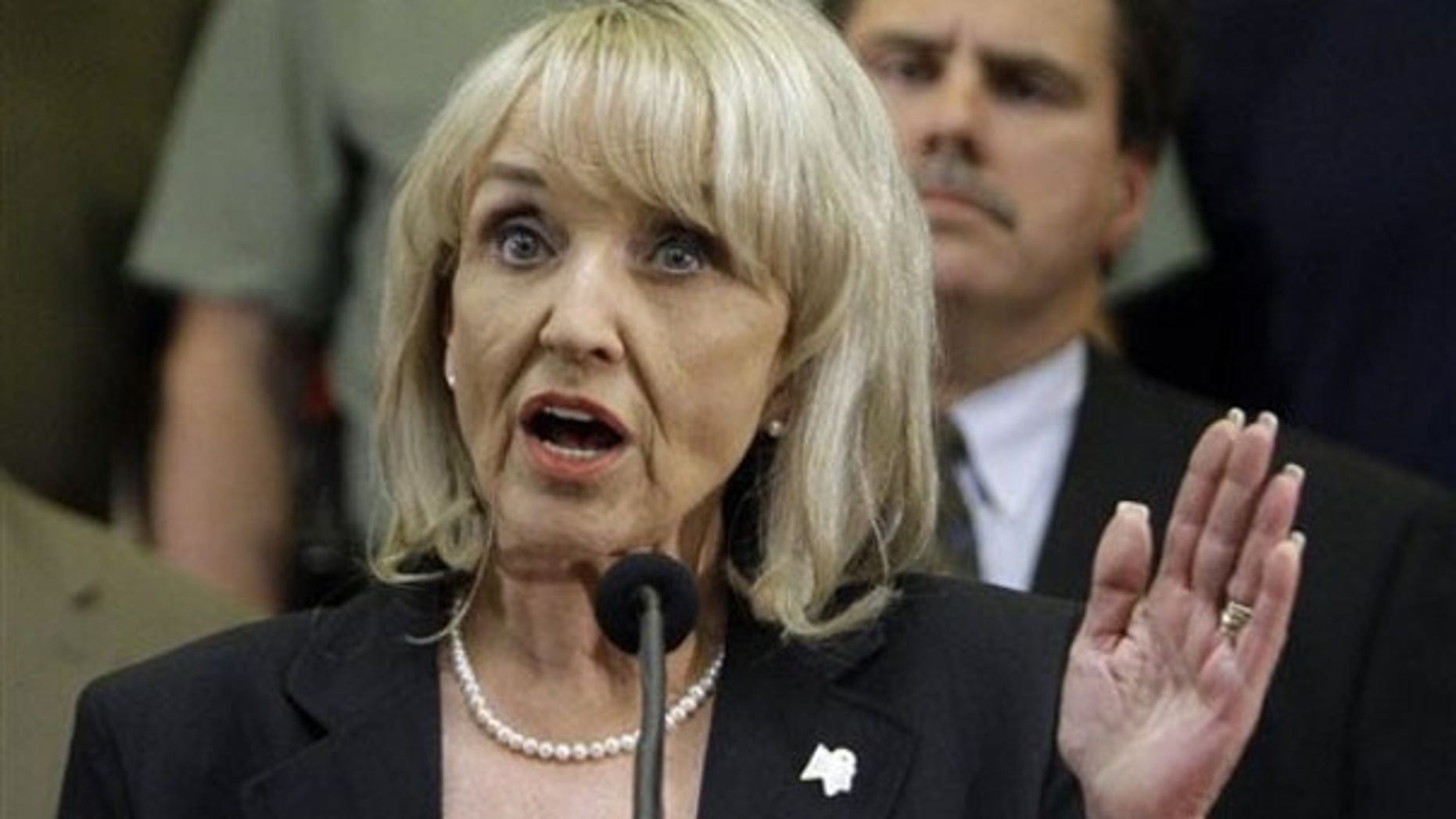 Arizona Gov. Jan Brewer is shown here discussing her state's controversial immigration bill April 23 in Phoenix. (AP Photo)