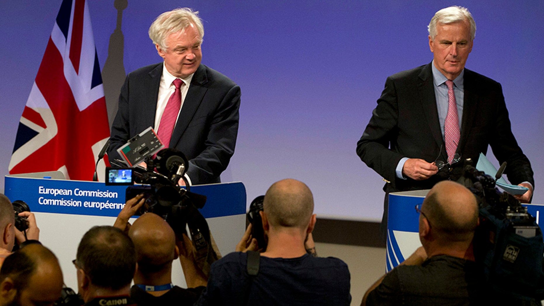 June 19, 2017: EU Chief Brexit Negotiator Michel Barnier, right, and British Secretary of State for Exiting the EU David Davis arrive for a media conference at EU headquarters in Brussels.