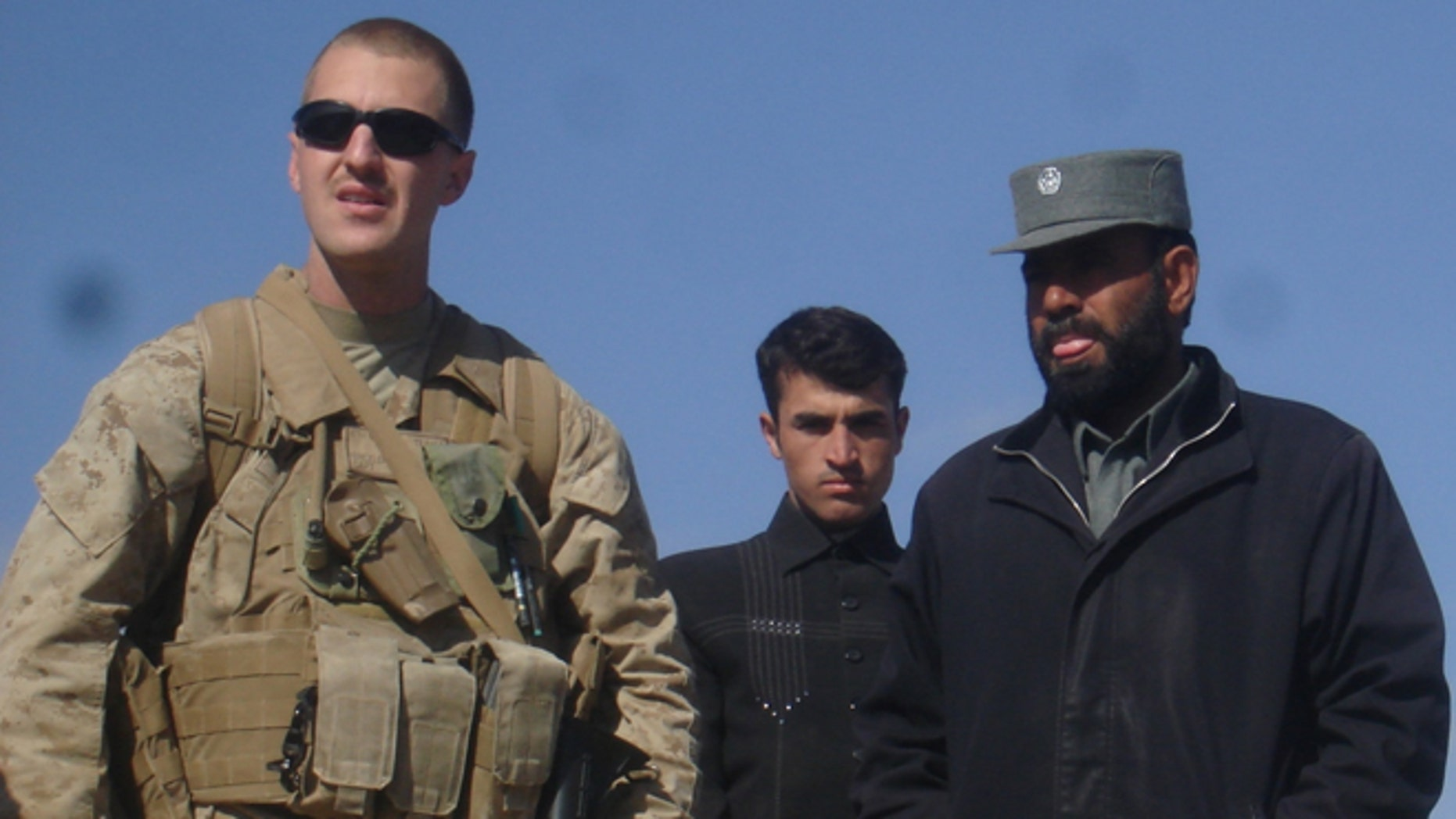 FILE: Marine reservist Jason Brezler, left, is pictured with Afghan police chief and alleged child abuser Sarwar Jan, whom Brezler warned his fellow Marines about before one of Jan's alleged victim's fatally shot three Marines.