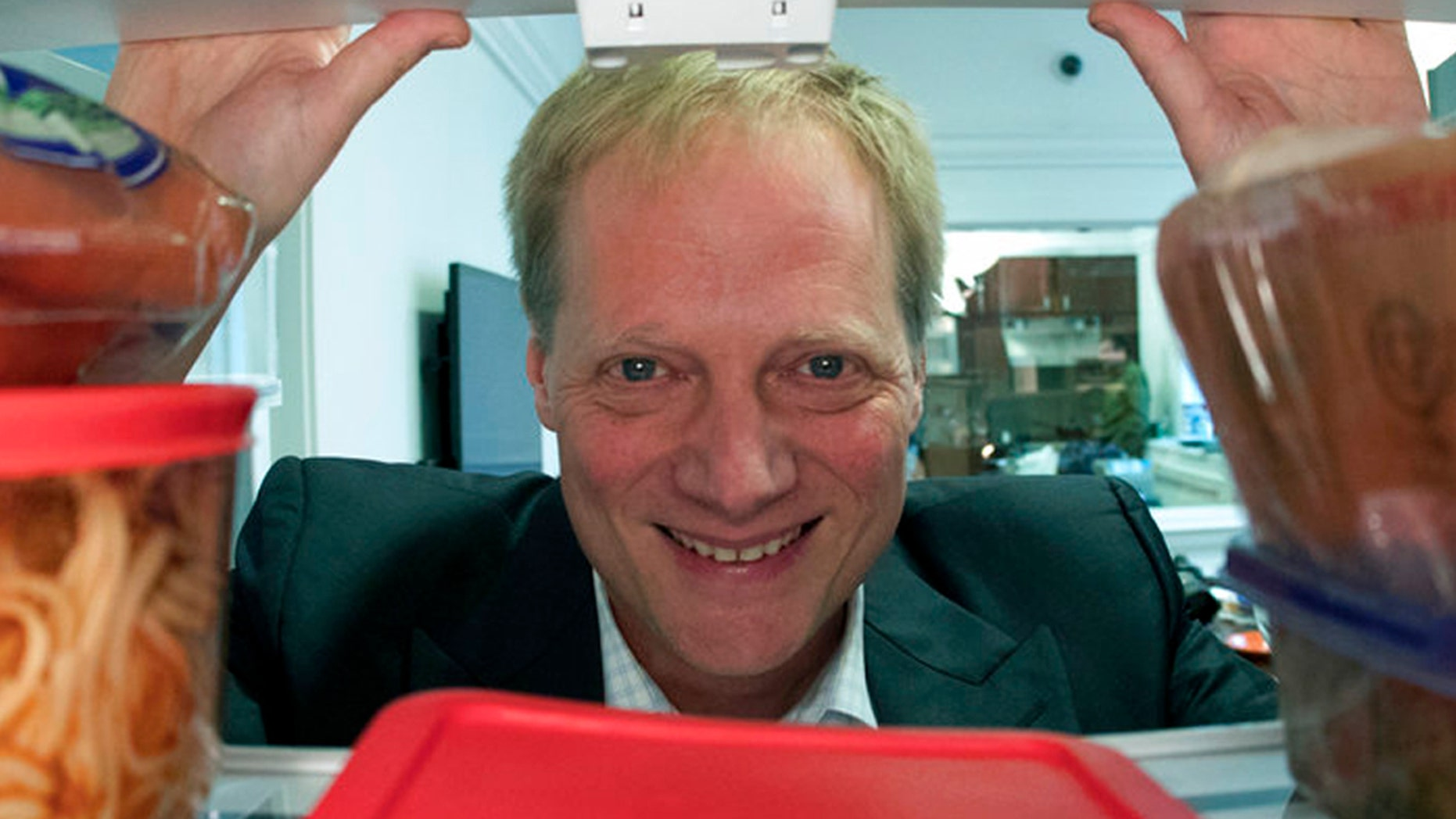 In this Dec. 6, 2016 file photo, Brian Wansink poses for a photo in a food lab at Cornell University in Ithaca, N.Y. On Friday, Sept. 21, 2018, the prominent food researcher is defending his work a day after Cornell University said he engaged in academic misconduct and was removed from all teaching and research positions.