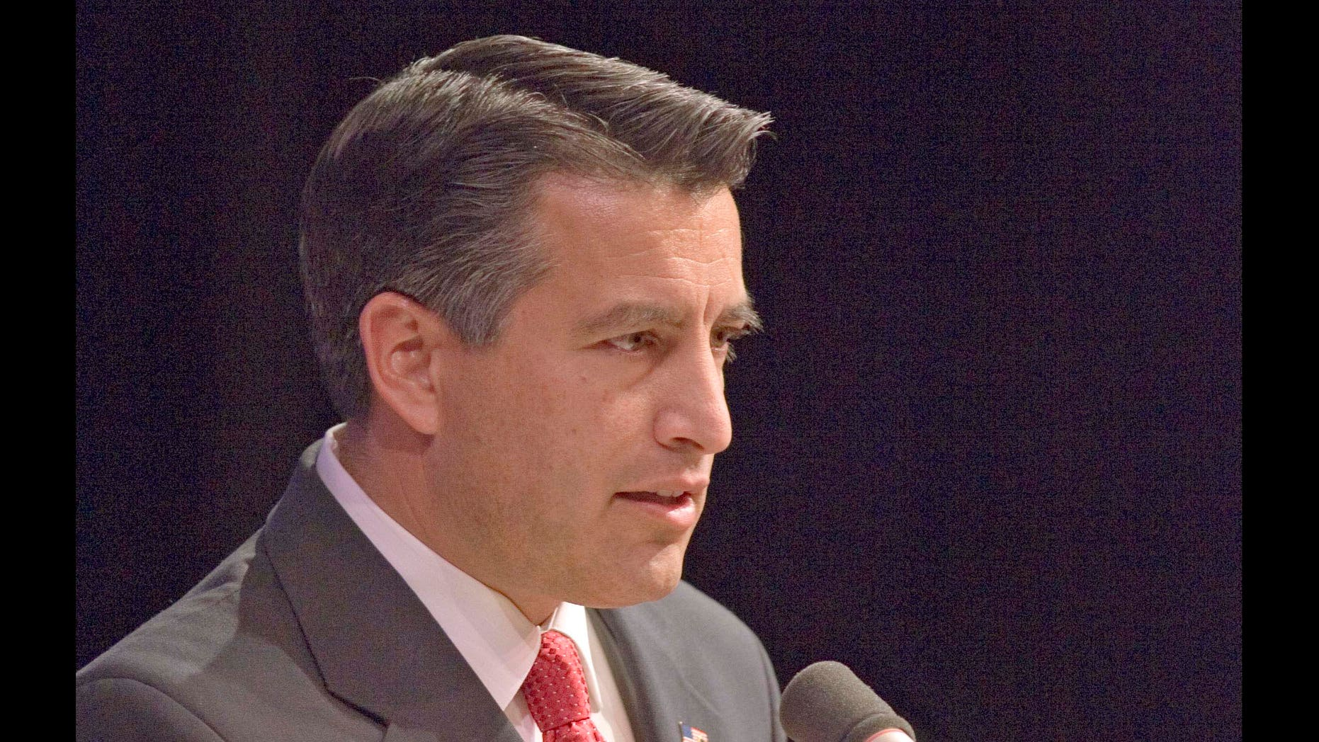 Gubernatorial candidate Brian Sandoval  talks about  Nevada issues during a debate with opponent  Rory Reid Tuesday night, Oct 26, 2010 at Great Basin College Theater in Elko, Nev.  Insults were traded and reputations questioned in a feisty debate Tuesday between Nevada gubernatorial candidates over the state's budget crisis, political ambitions and job experience as early voting winds down and Election Day looms. (AP Photo/Elko Daily Free Press, Ross Andreson).