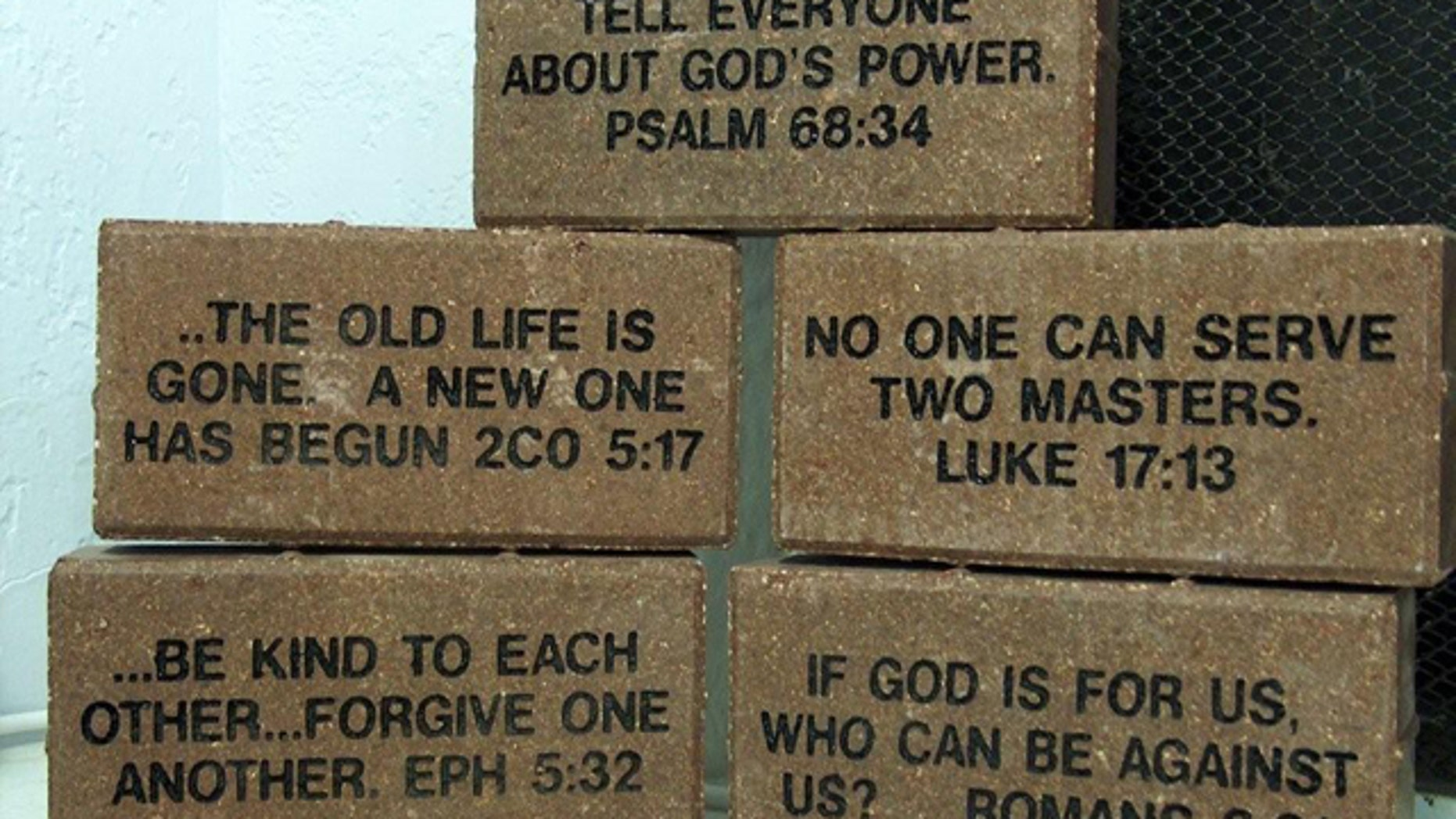 The bricks, seen above, were inscribed with Bible verses to be installed at California's Palm Desert High School. District officials have since decided to cancel the fundraiser and refund money of every community group or individual who purchased a memorial brick, according to a court filing last week. (ADF.org)