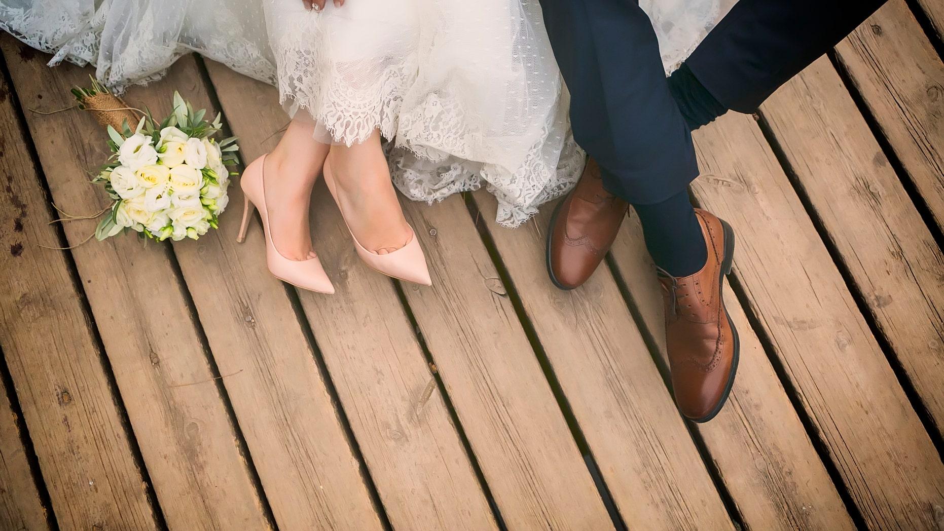 feet of bride and groom, wedding shoes (soft focus). Cross processed image for vintage lookfeet of bride and groom, wedding shoes (soft focus). Cross processed image for vintage look