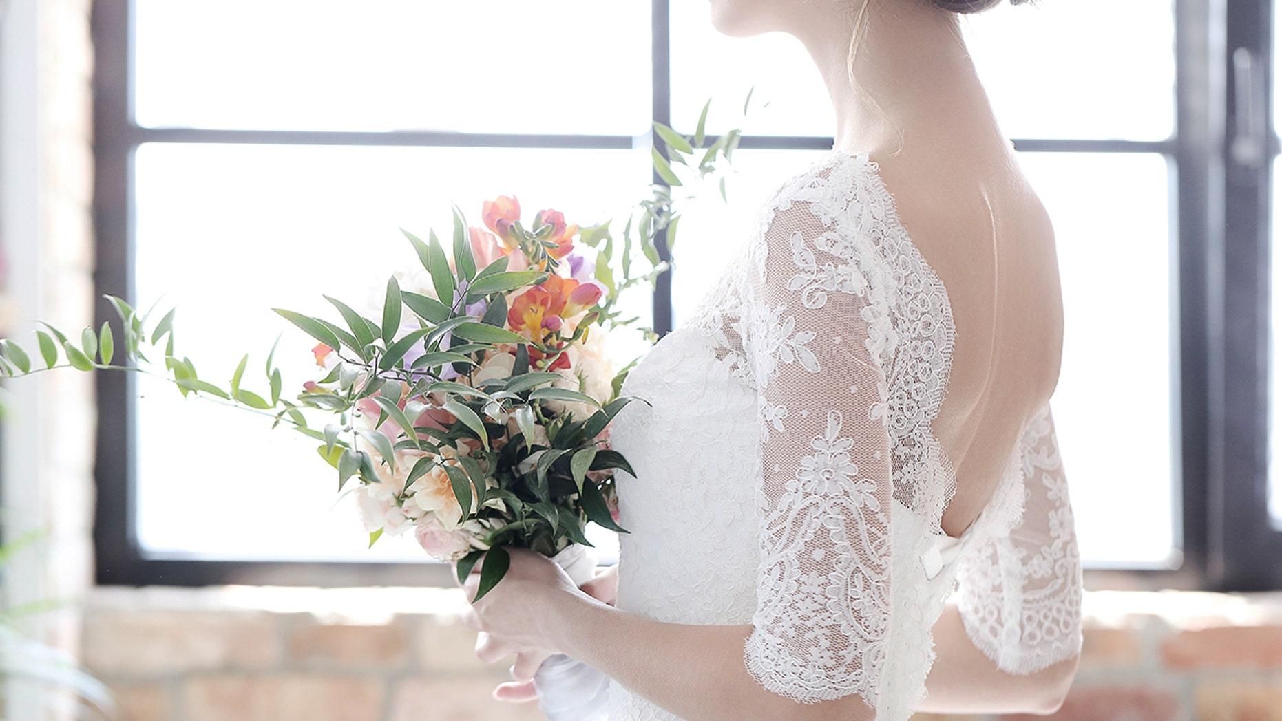 A bride surprised her grandmother by wearing her vintage wedding dress