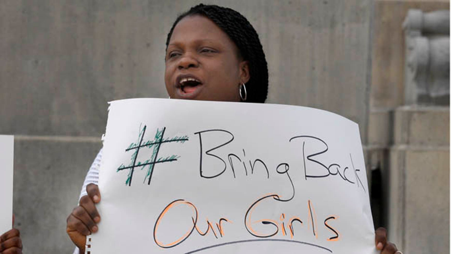 May 10, 2014: A woman at a rally to raise awareness about the abduction of school girls in Nigeria, Salt Lake City, Nevada.