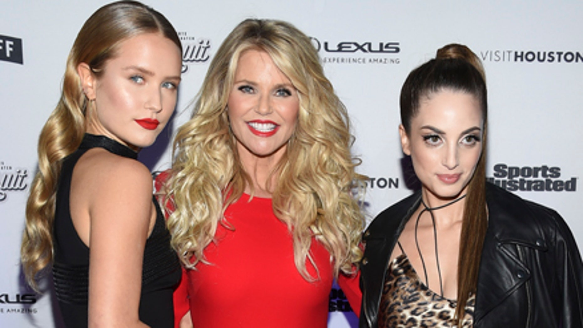 Christie Brinkley, center, and her daughters, from left, Sailor Brinkley Cook and Alexa Ray Joel attend the Sports Illustrated Swimsuit 2017 launch event at Center415 on Thursday, Feb. 16, 2017, in New York.