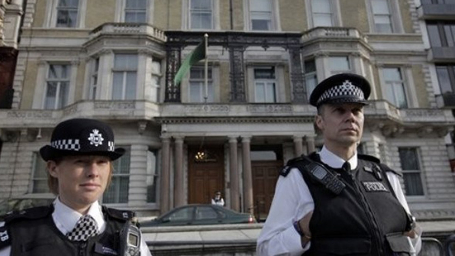 May 1: British police officers guard Libya's embassy in London
