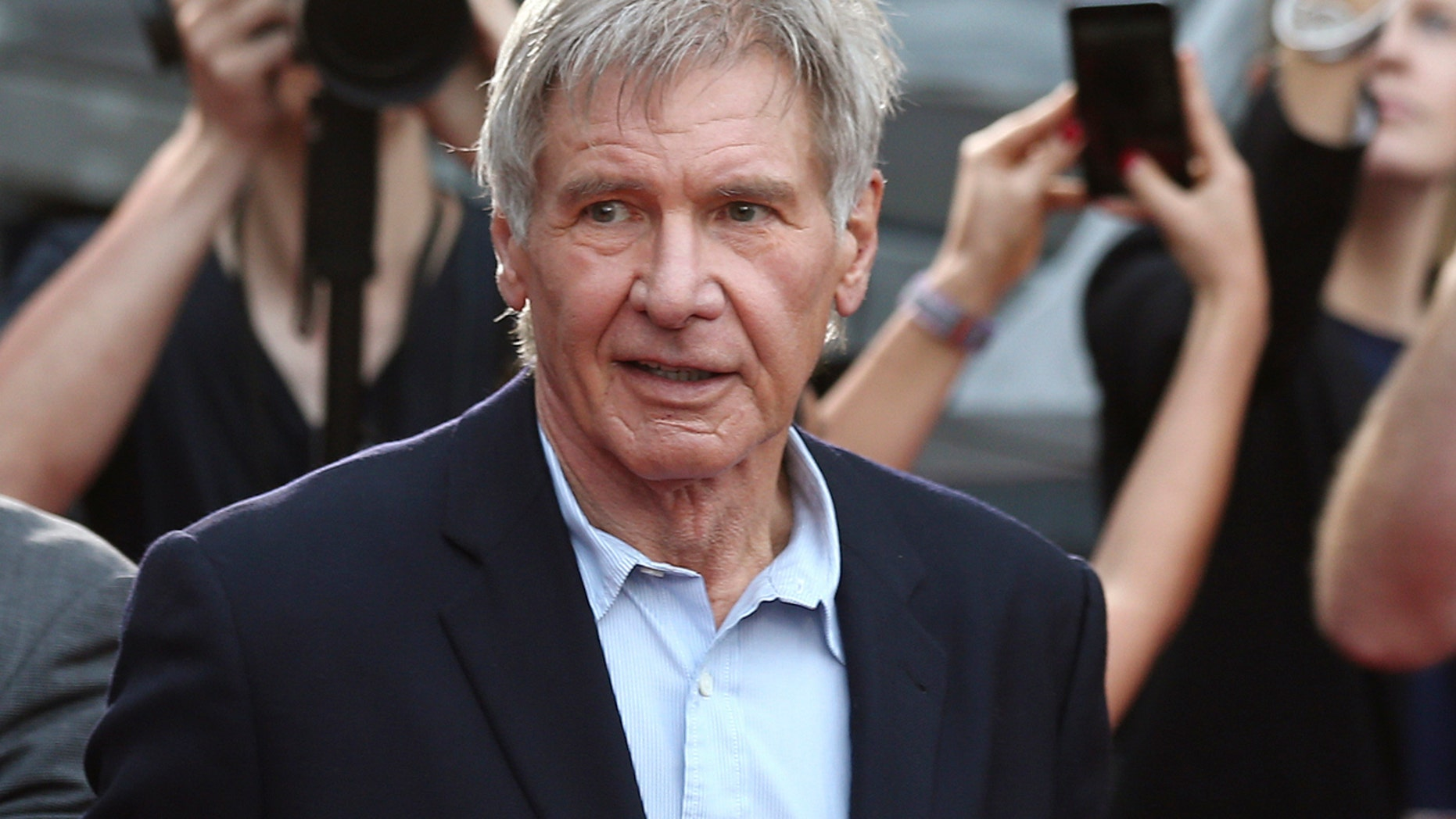 "Dec. 10, 2015: Harrison Ford greets fans during a Star Wars fan event in Sydney. A film production company has been fined 1.6 million pounds ($1.95 million) over an accident on the set of ""Star Wars: The Force Awakens"" that broke the leg of star Harrison Ford."