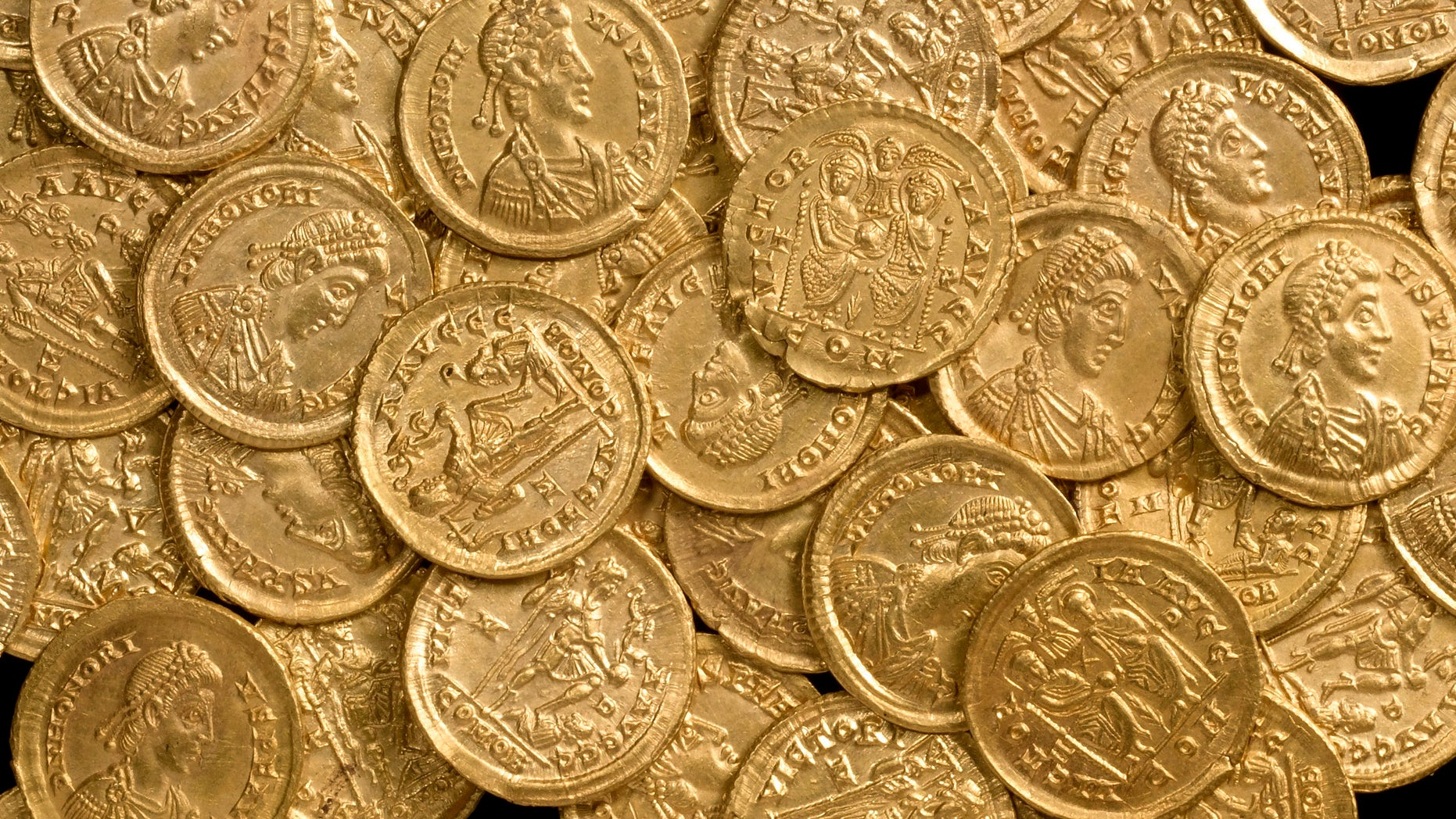 Oct. 17, 2012: In this undated photo released by St Albans City and District Council, late Roman gold coins, examples of the solidus, a high-value coin struck in the late fourth century, are photographed before going on display at the Verulamium Museum, St Albans, England. A curator at the museum says the coins, found on private land north of St. Albans, would have been used for major transactions such as buying land or ship cargoes.