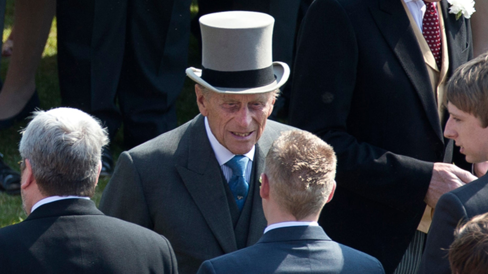 """June 6, 2013: Prince Philip, center, the husband of Britain's Queen Elizabeth II attends a garden party at Buckingham Palace in London.  Buckingham Palace says Queen Elizabeth II's husband was later admitted to a London hospital for an exploratory operation. The palace said the operation on 91-year-old Prince Philip will come after """"abdominal investigations,"""" but did not elaborate.  ("""