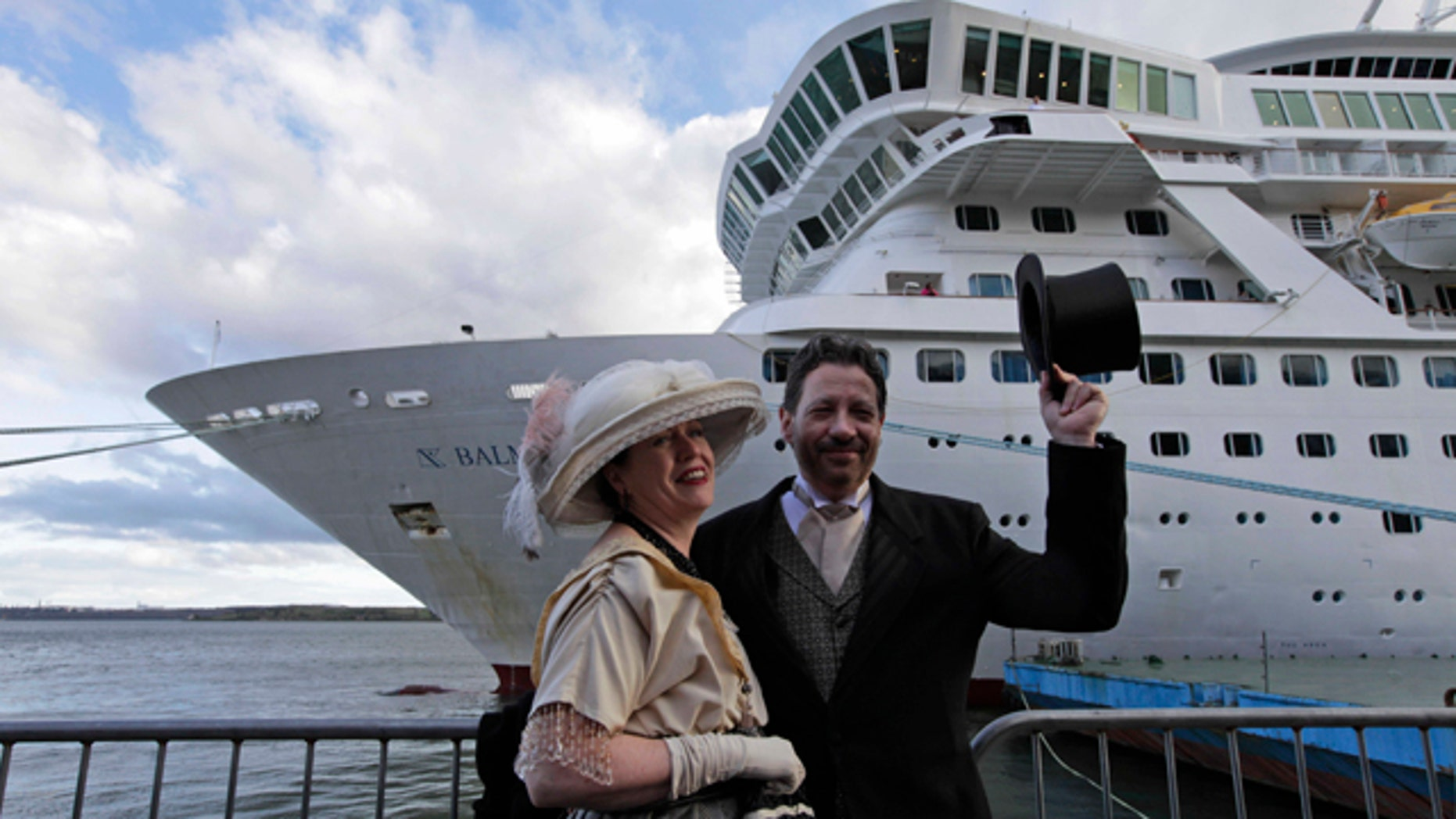 April 9, 2012: Mary Beth Crocker, left, and her husband Tom Dearing from Newport Ky. pose for pictures in period costume as they disembark the MS Balmoral Titanic memorial cruise ship at its first stop in Cobh, Ireland.