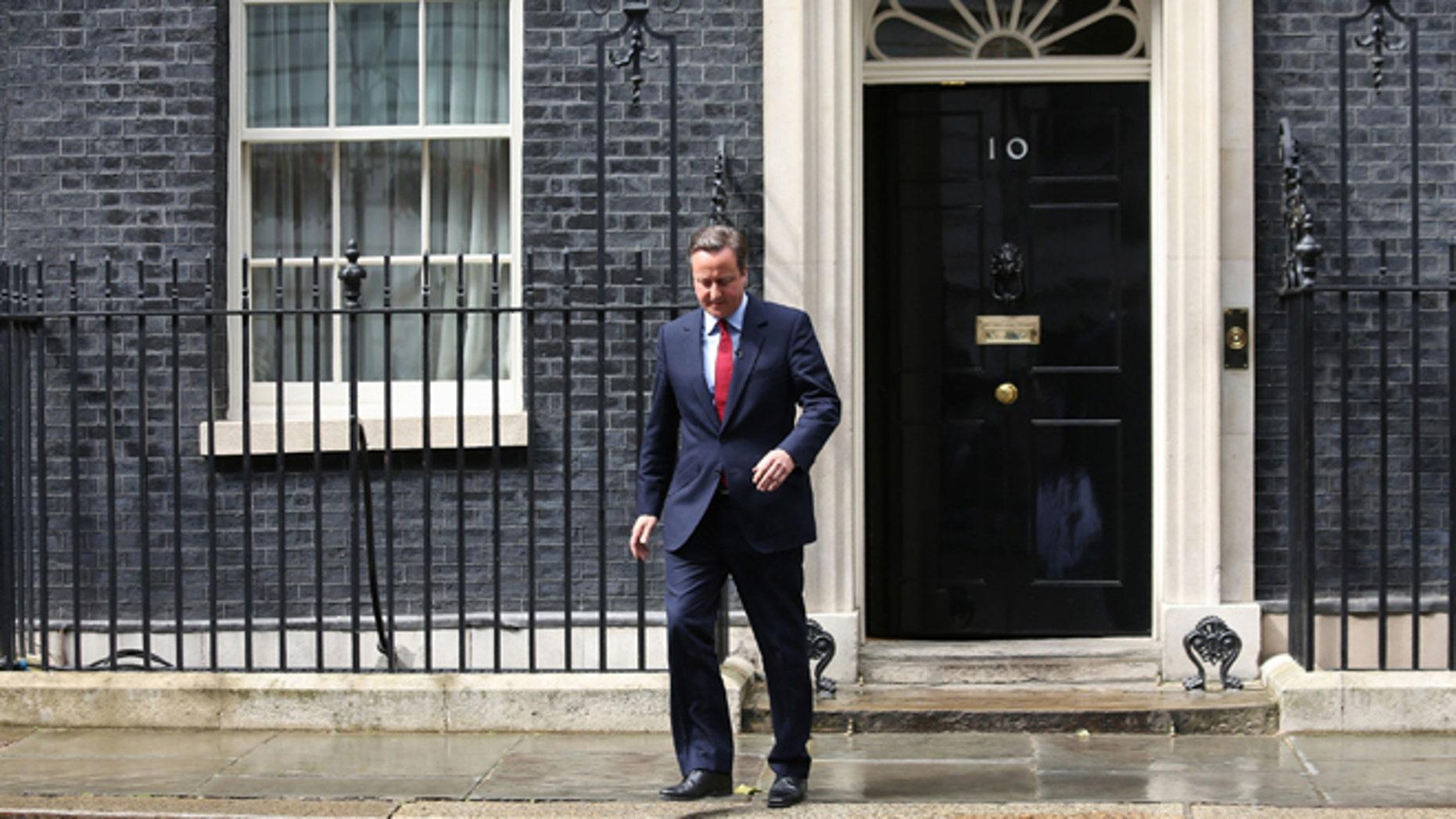 July 11: Britain's PM David Cameron walks outside No. 10 Downing Street.