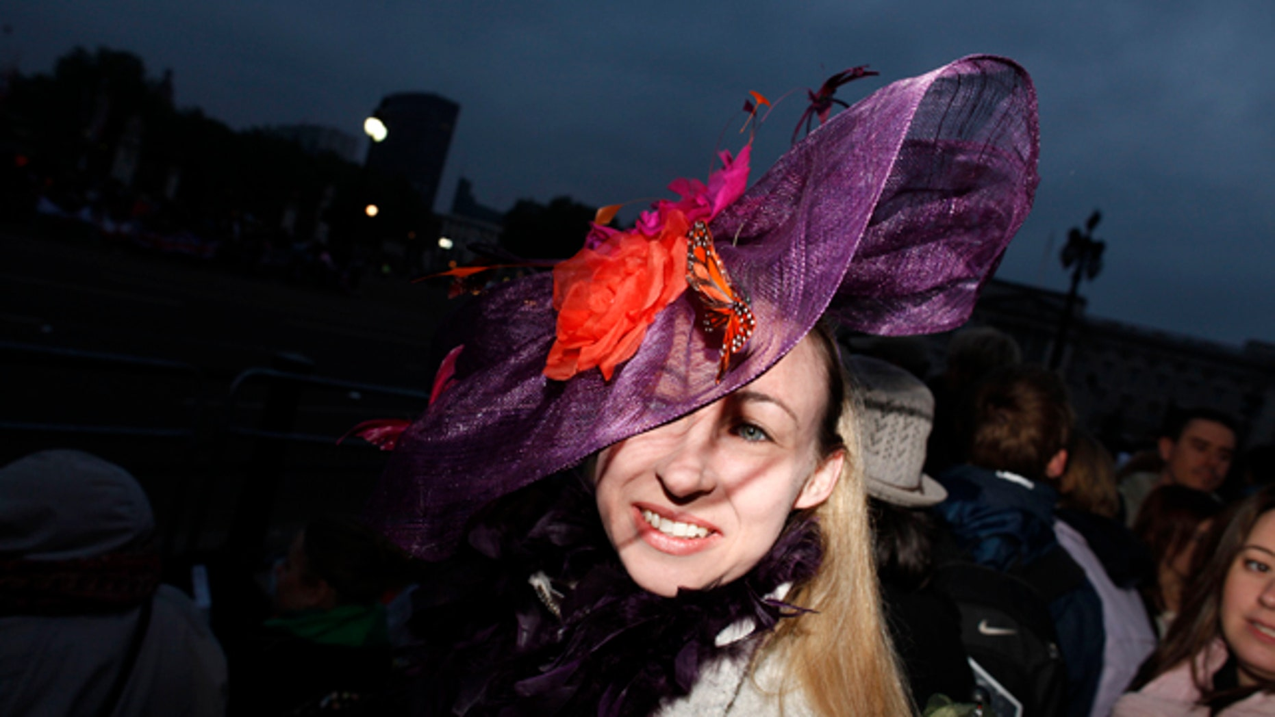 April 29: Christine Peckham from London wears a fancy hat along the Royal Wedding route in London on Friday. (AP)
