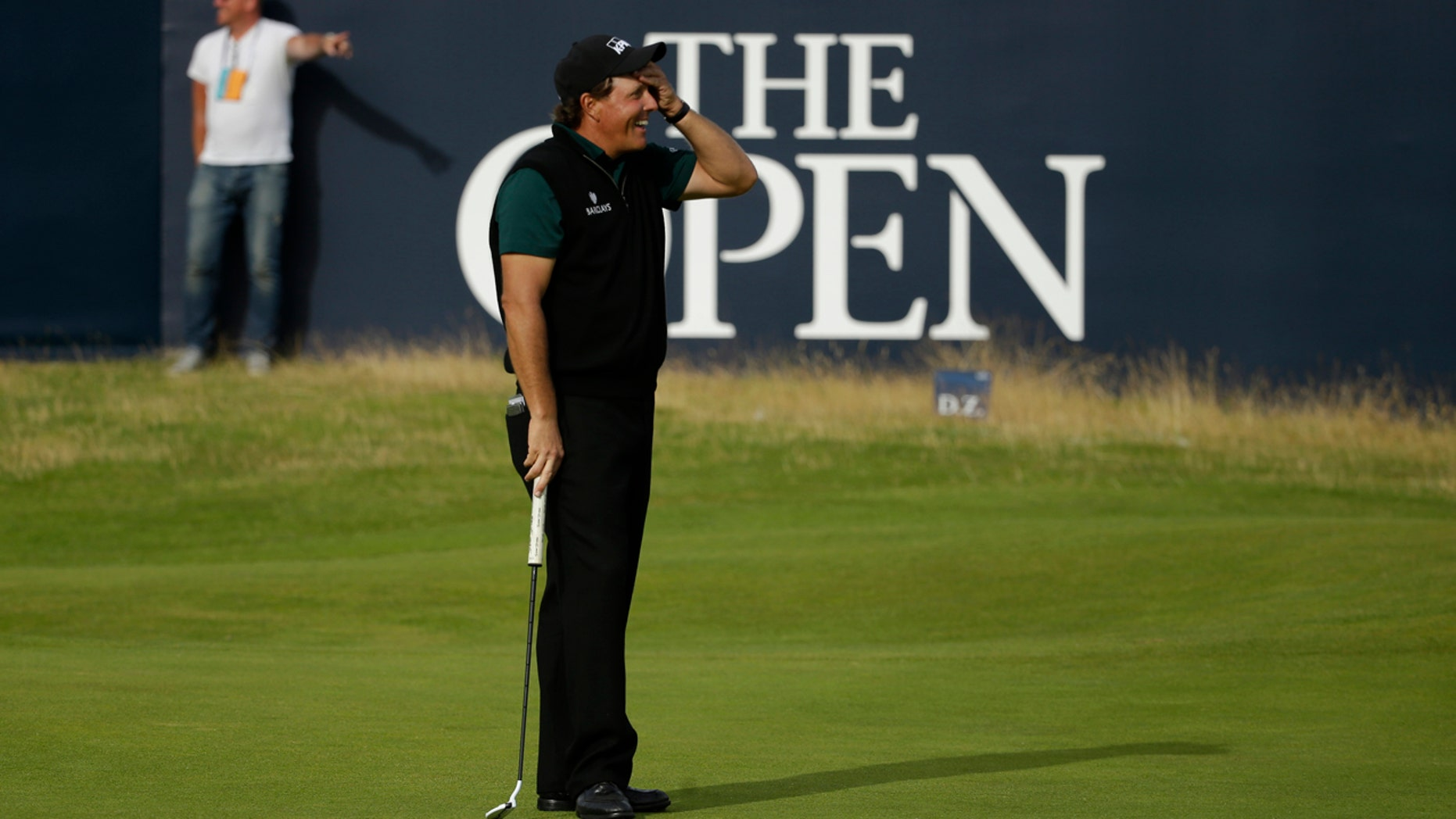July 14, 2016: Phil Mickelson reacts as he narrowly misses a birdie putt on the 18th green during the first round of the British Open Golf Championships at the Royal Troon Golf Club in Troon, Scotland.
