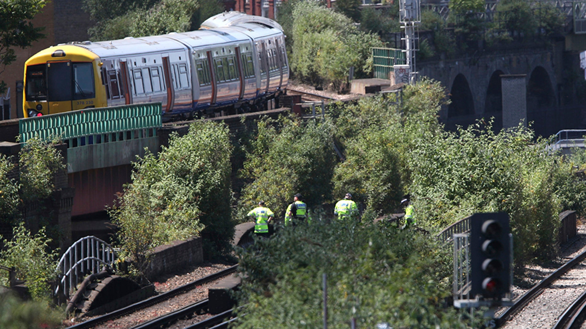 June 18, 2018: Police officers inspect a railway track near Loughborough Junction railway station, in south London.