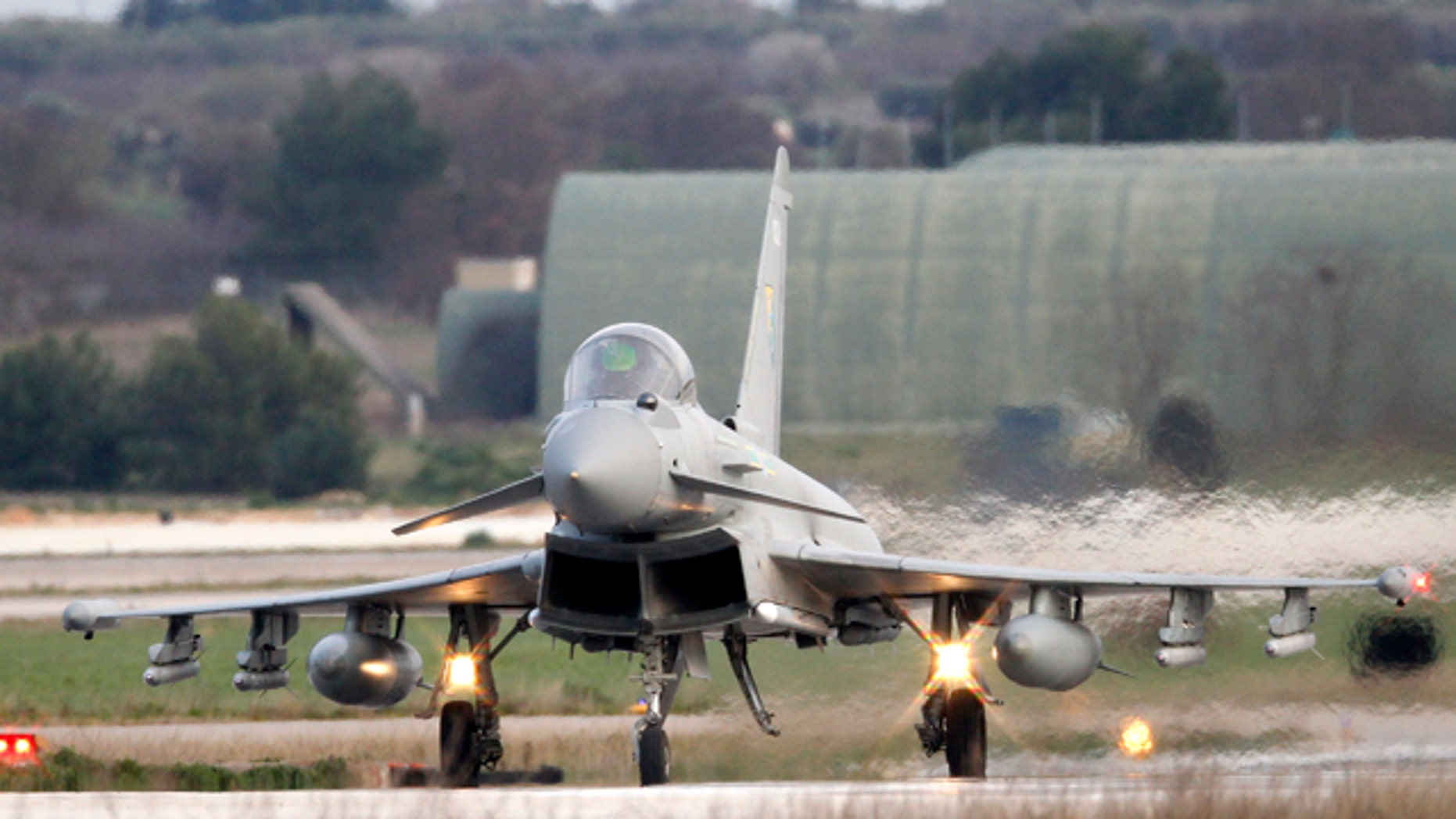 March 20: A British Typhoon jet lands at a NATO airbase in southern Italy.