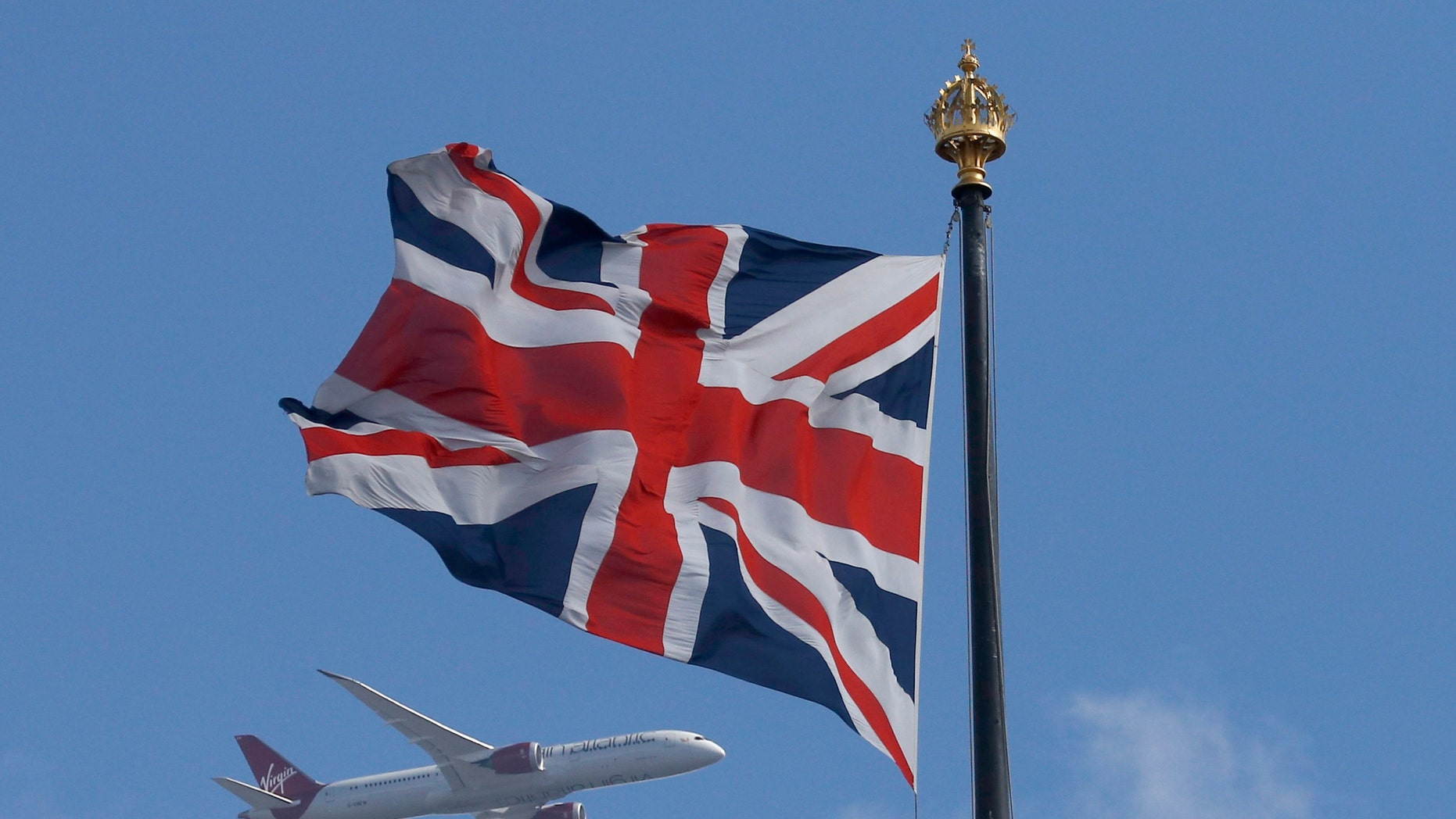 File photo - A Virgin Atlantic passenger jet flies past the Union Flag above the Houses of Parliament in Westminster, in central London, Britain June 24, 2016. (REUTERS/Phil Noble)